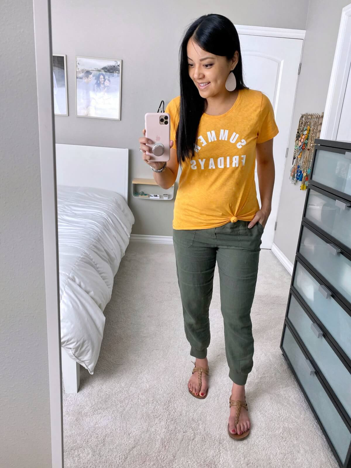 Comfy Casual Outfit: yellow graphic tee + olive linen pants + tan braided thong sandals + blush leather earrings
