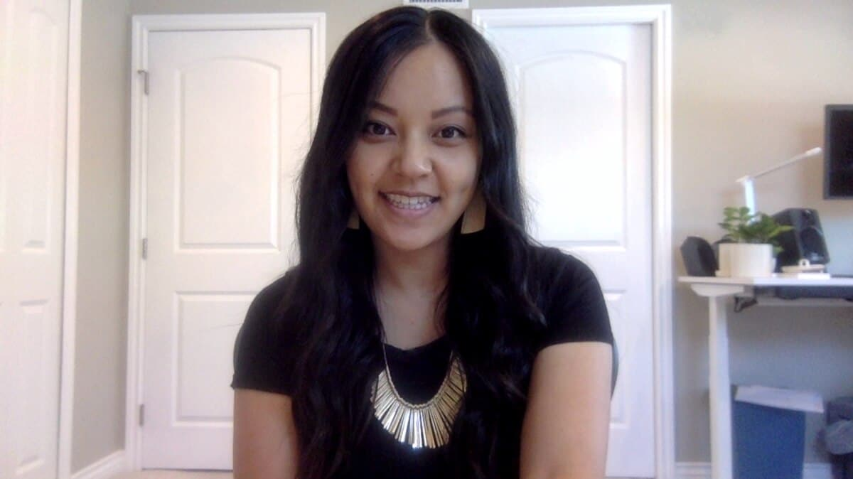 Casual Work Video Call Outfit: black tee + statement necklace + tan leather earrings