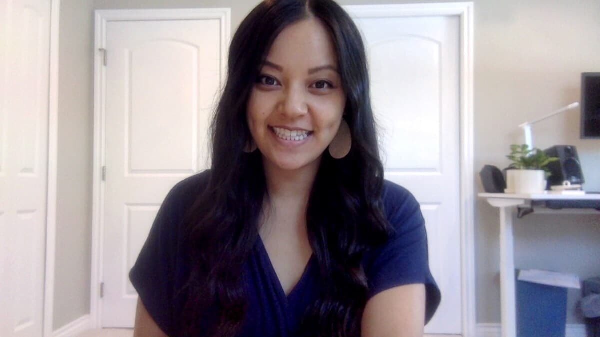 Work Video Call Outfit: navy jumpsuit and metallic leather earrings
