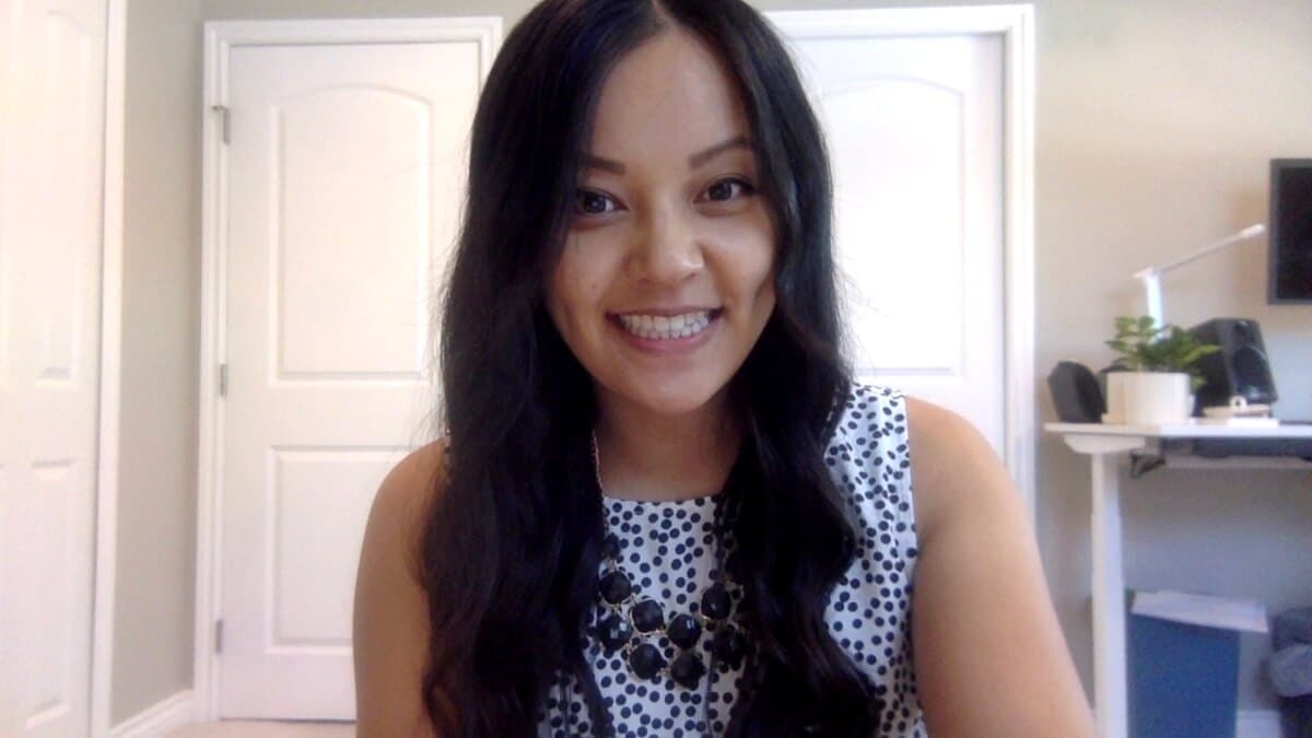 Work Video Call Outfit: black and white spotted sleeveless top + black statement necklace
