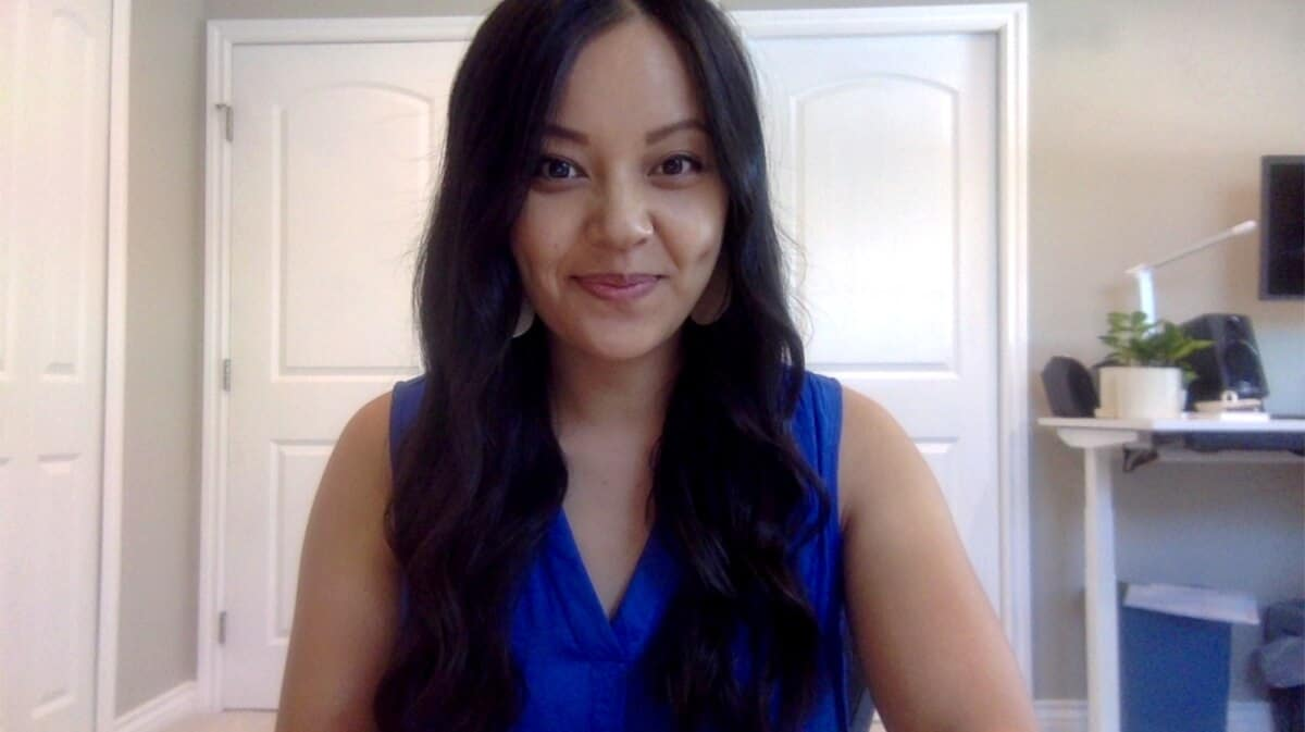 Work Video Call Outfit: blue v-neck sleeveless top + metallic leather earrings