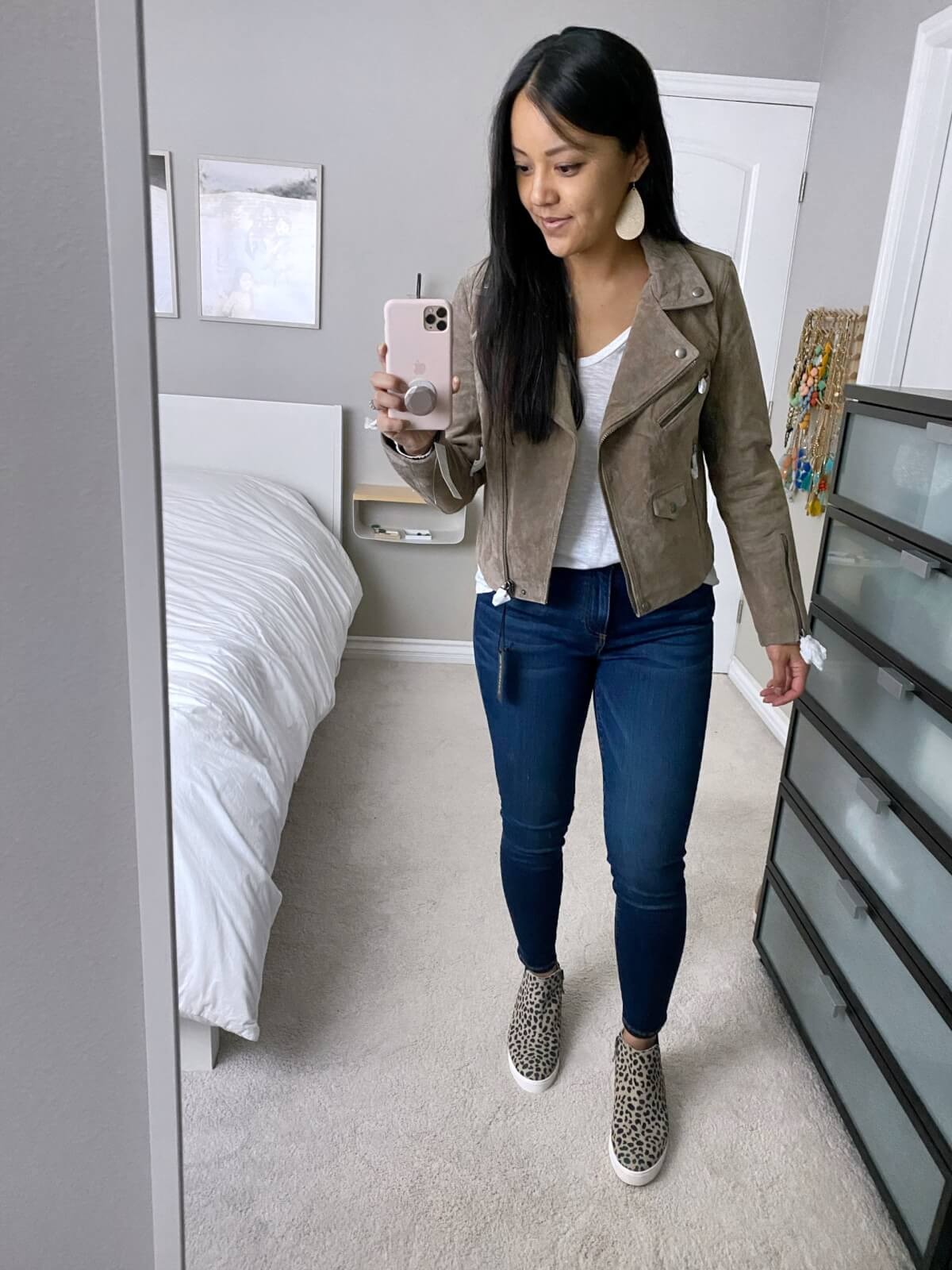 Elevated Casual Fall Outfit: white tee + taupe suede moto jacket + skinny jeans + leopard print wedge sneakers + gold leather earrings