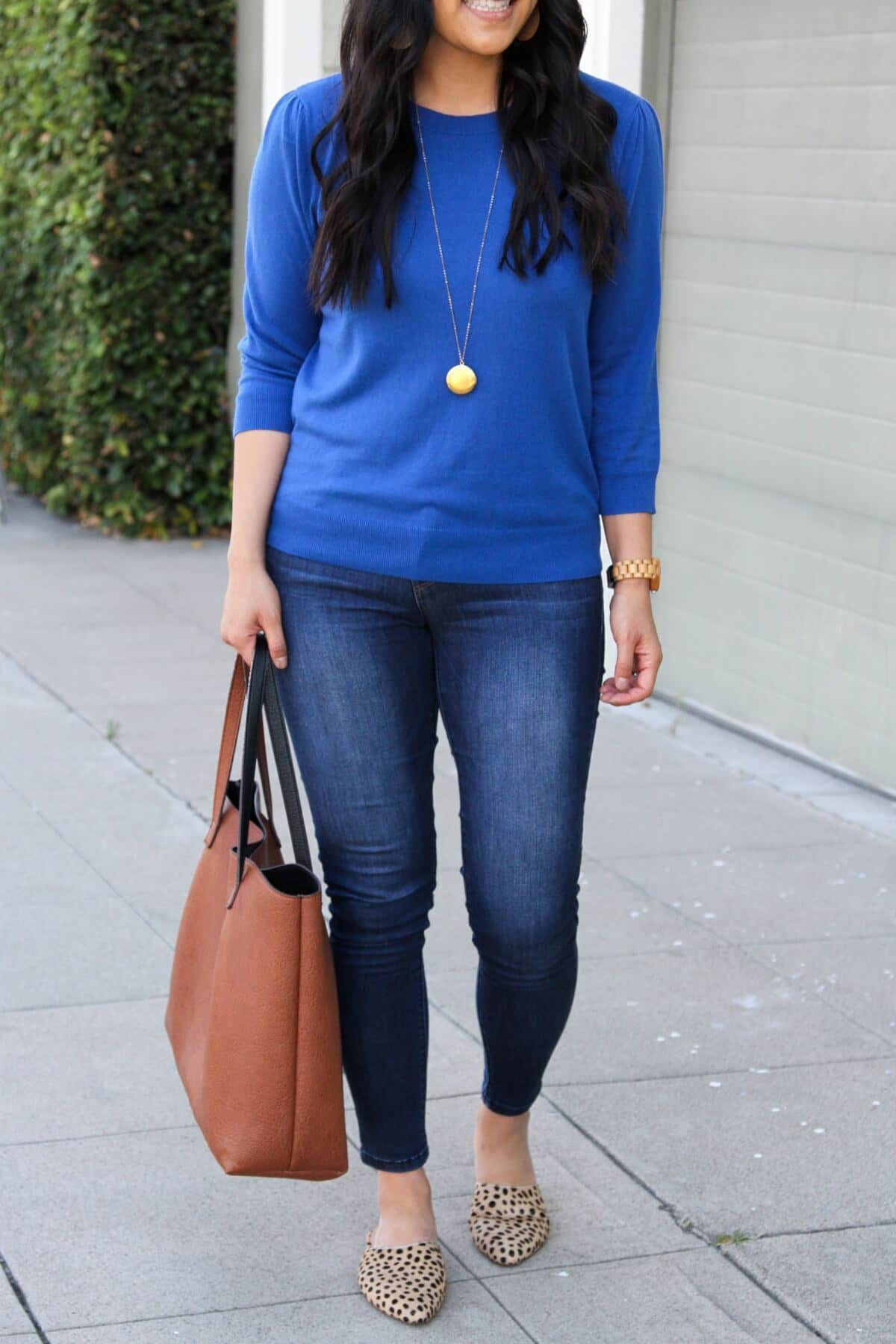 Casual Fall Outfit: skinny jeans + blue sweater + cognac tote + leopard mules + gold leather earrings + gold circle pendant necklace