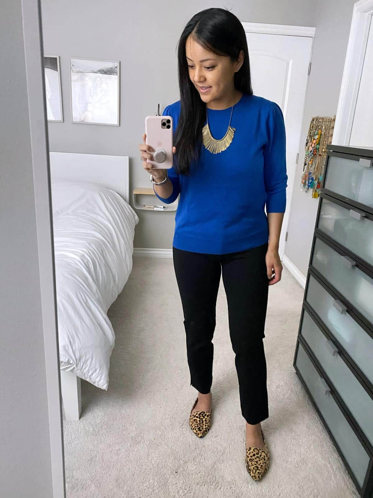 Business Casual Outfit: blue sweater + black ankle pants + leopard print loafers + gold fringe statement necklace