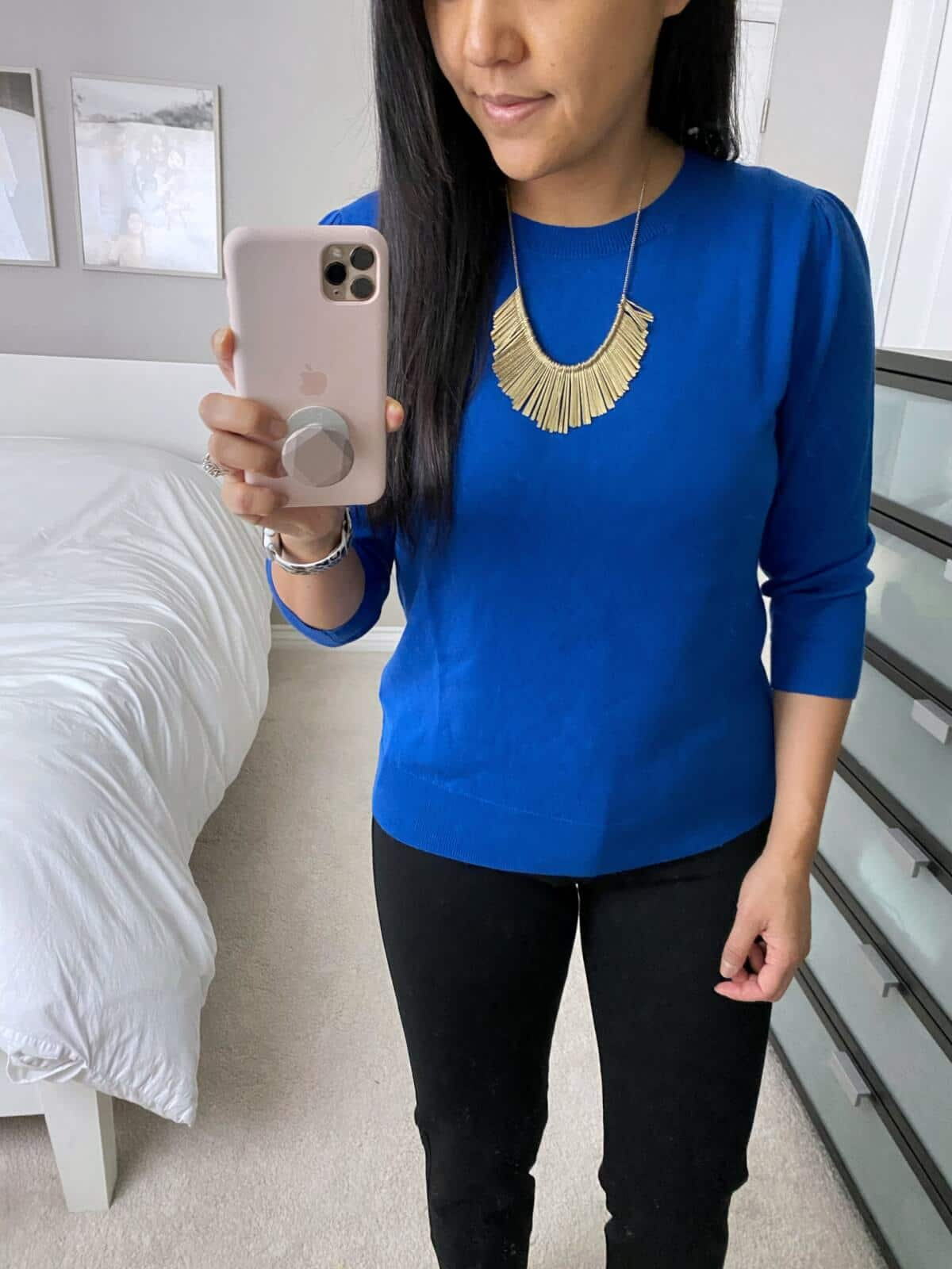 Business Casual Outfit: black ankle pants + blue sweater + gold fringe statement necklace