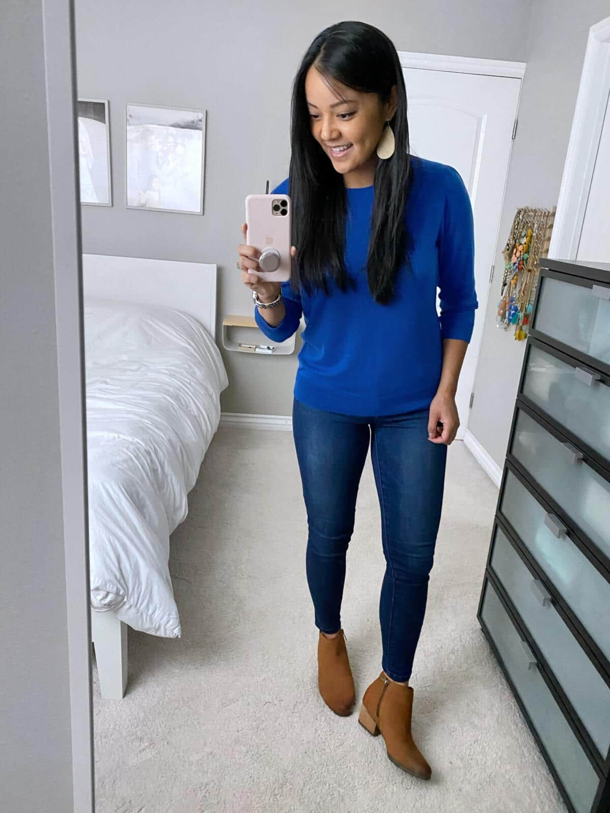 Fall Jeans Outfit: blue sweater + skinny jeans + tan booties + gold leather earrings