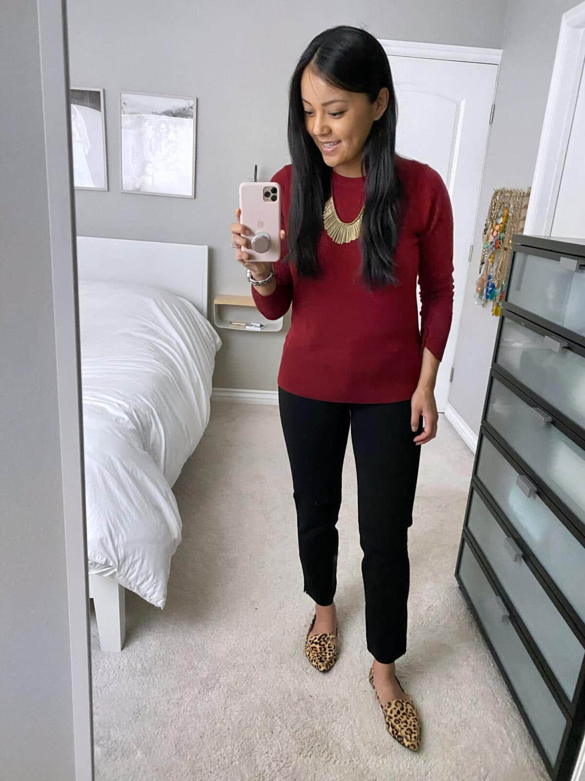 Business Casual Outfit: red sweater + black ankle pants + leopard print loafers + gold fringe statement necklace