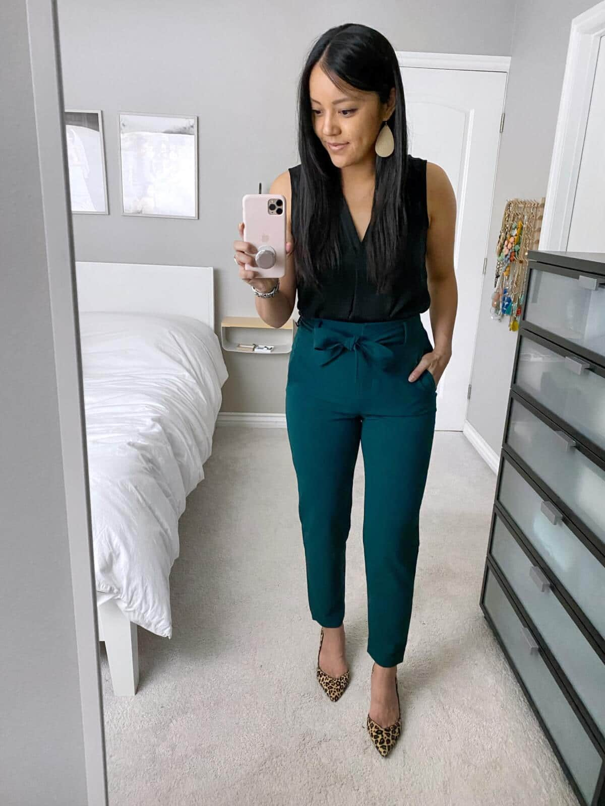 Business Casual Outfit: black v-neck tank + green tie-waist pants + leopard heels + gold leather earrings