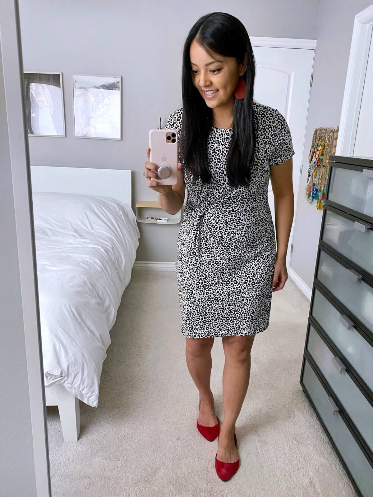 Business Casual Outfit: black and white spotted knot-waist dress + red faux suede flats + red leather earrings