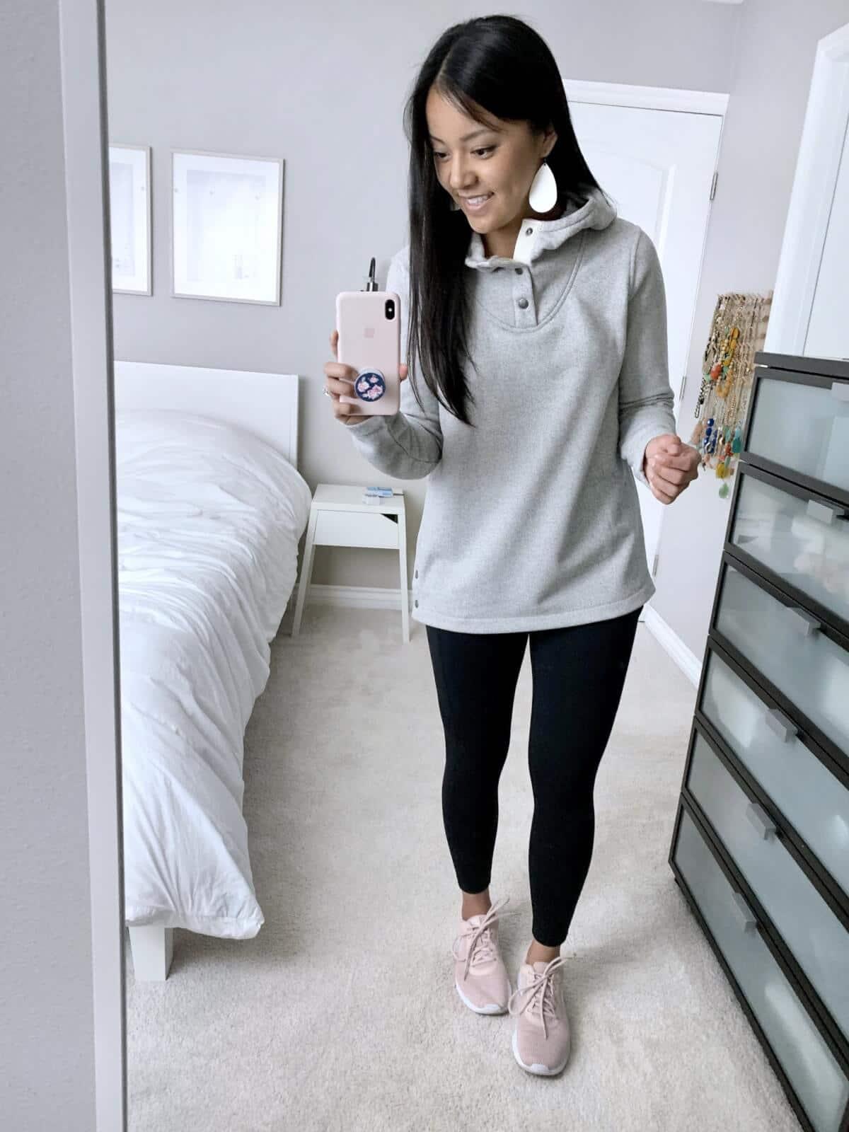 Loungewear Outfit: grey fleece hoodie + black leggings + blush sneakers + metallic leather earrings