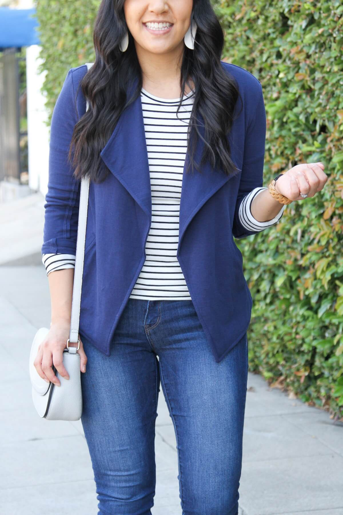 Business Casual Fall Outfit: navy knit blazer + long sleeve striped tee + leopard loafers + skinny jeans + white leather earrings + grey crossbody bag + long gold circle pendant necklace