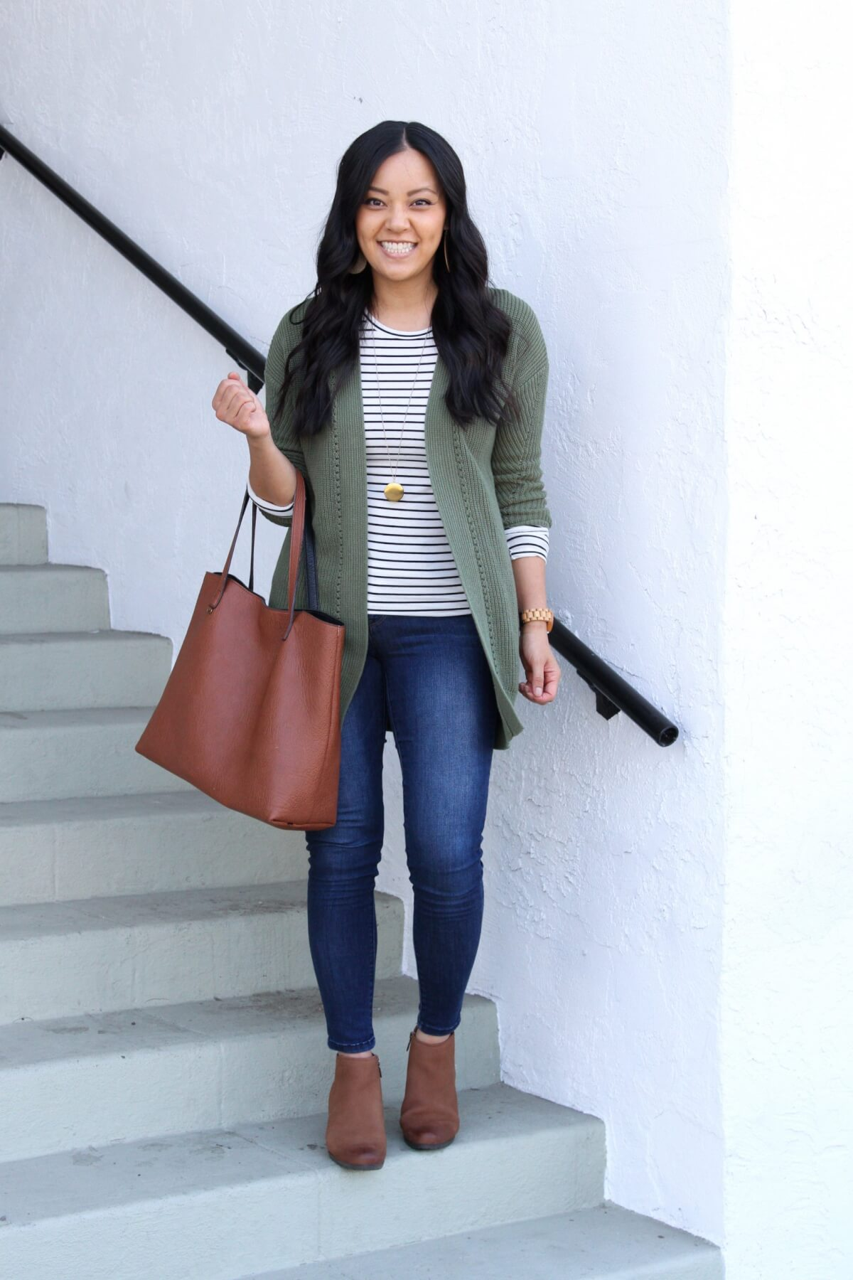 Casual Fall Outfit: long sleeve striped tee + olive cardigan + skinny jeans + cognac booties + cognac tote + long gold circle pendant necklace + tan cutout leather earrings