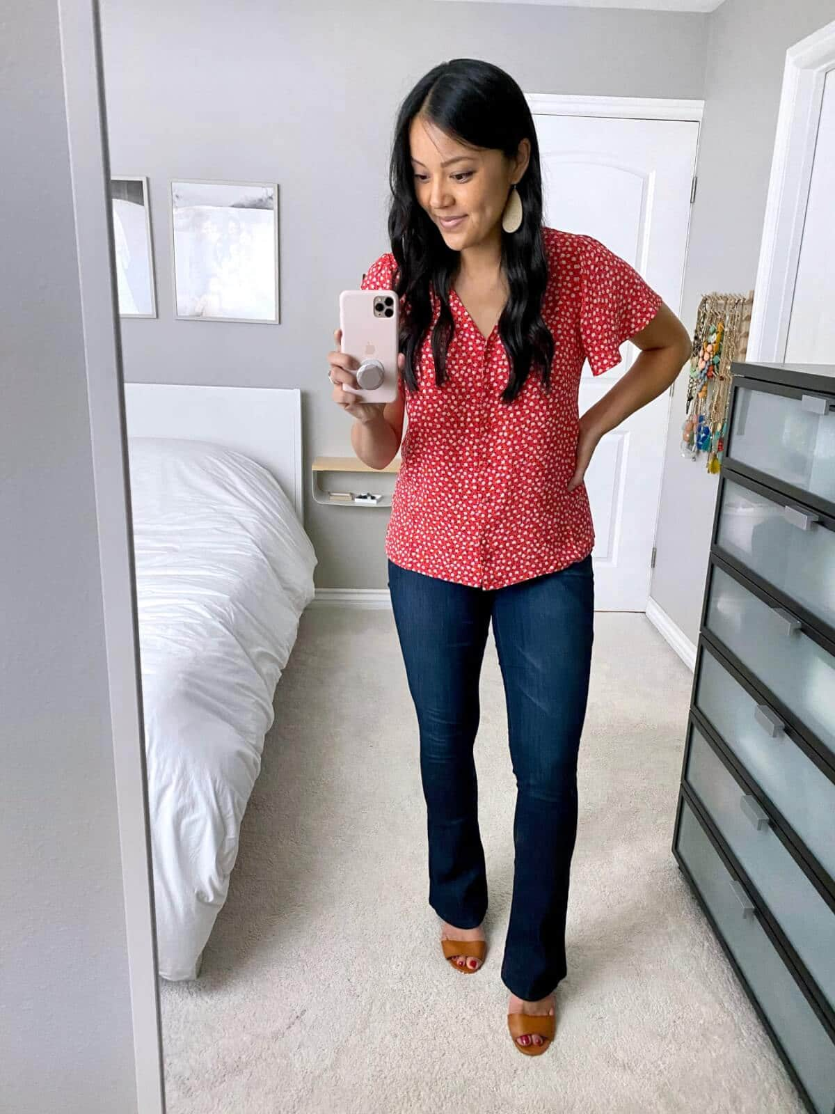 Casual Jeans Outfit: red and white printed flutter-sleeve blouse + bootcut jeans + tan sandals + gold leather earrings