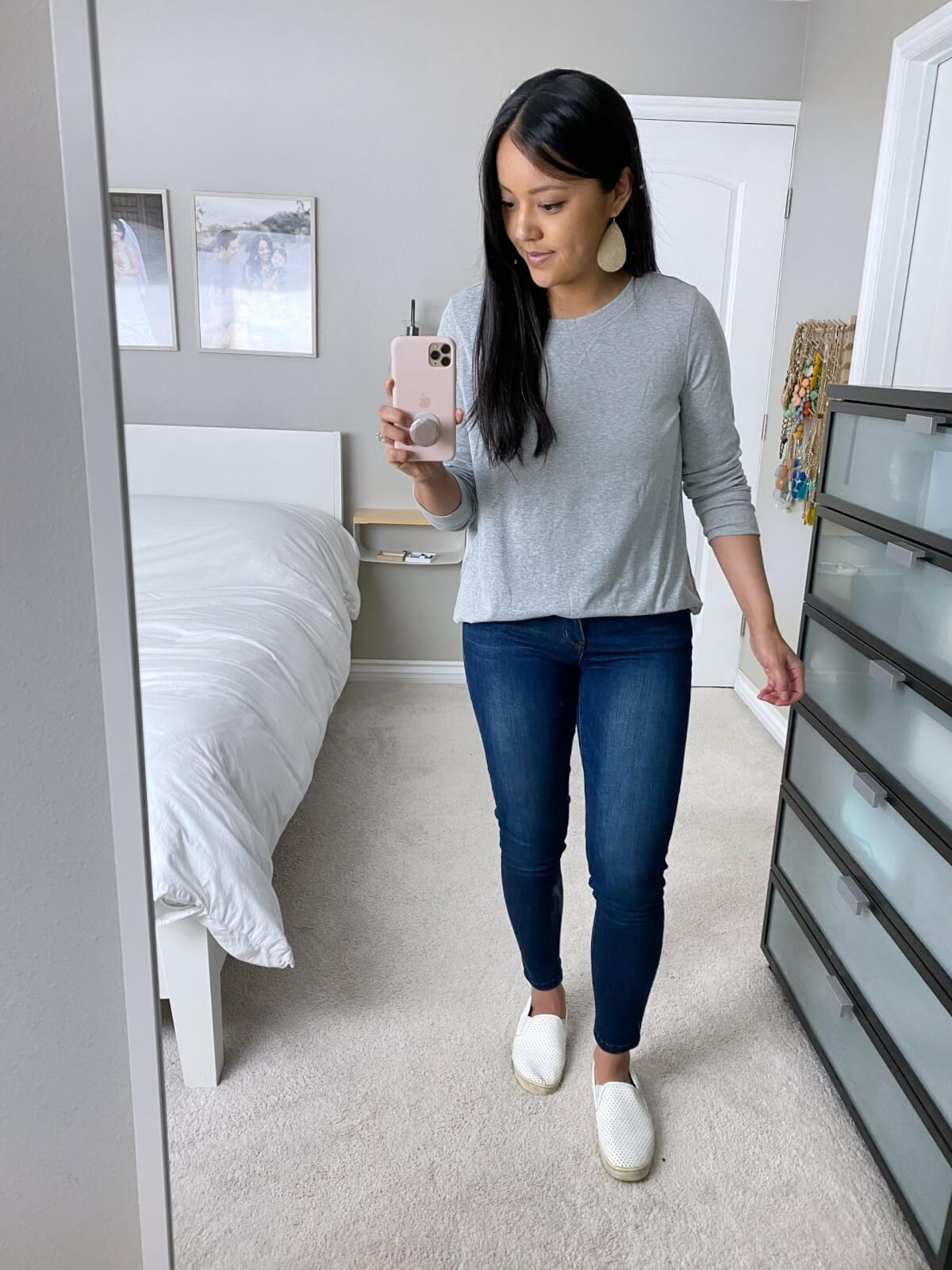 Casual Jeans Outfit: grey tunic top + skinny jeans + white slip-on sneakers + metallic leather earrings