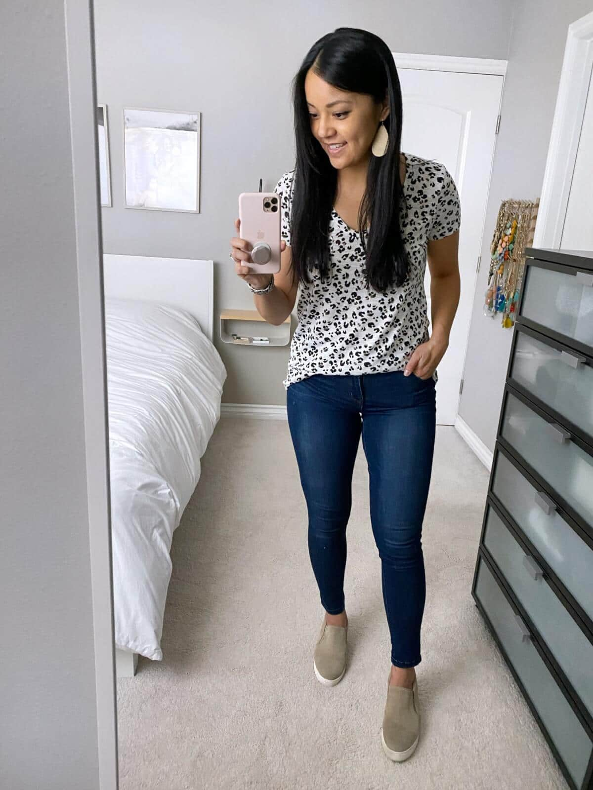 Fall Casual Outfit: leopard v-neck tee + skinny jeans + taupe slip-on sneakers + metallic leather earrings