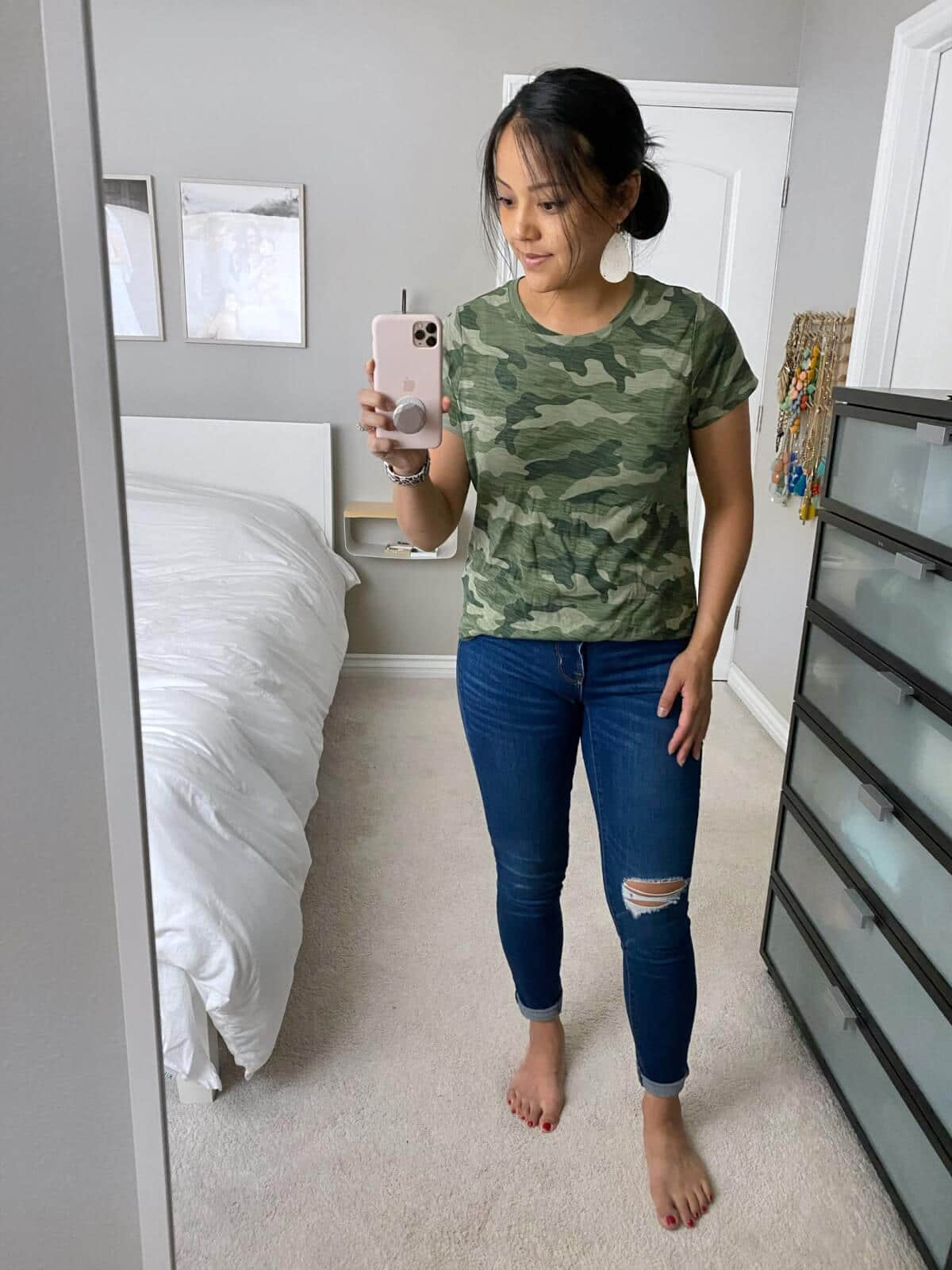 Casual Jeans Outfit: camo tee + distressed jeans + white leather earrings