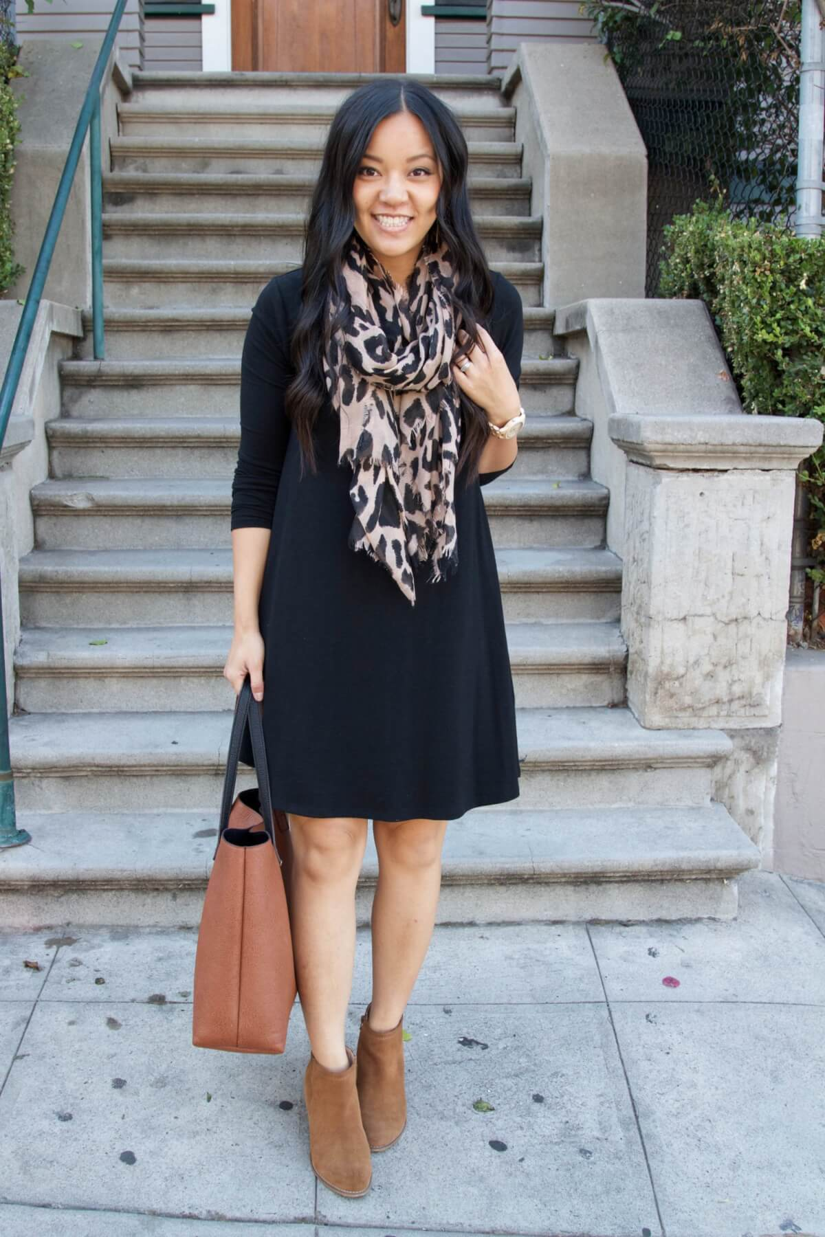 Fall Dress Outfit: black 3/4 sleeve swing dress + leopard scarf + tan booties + cognac tote