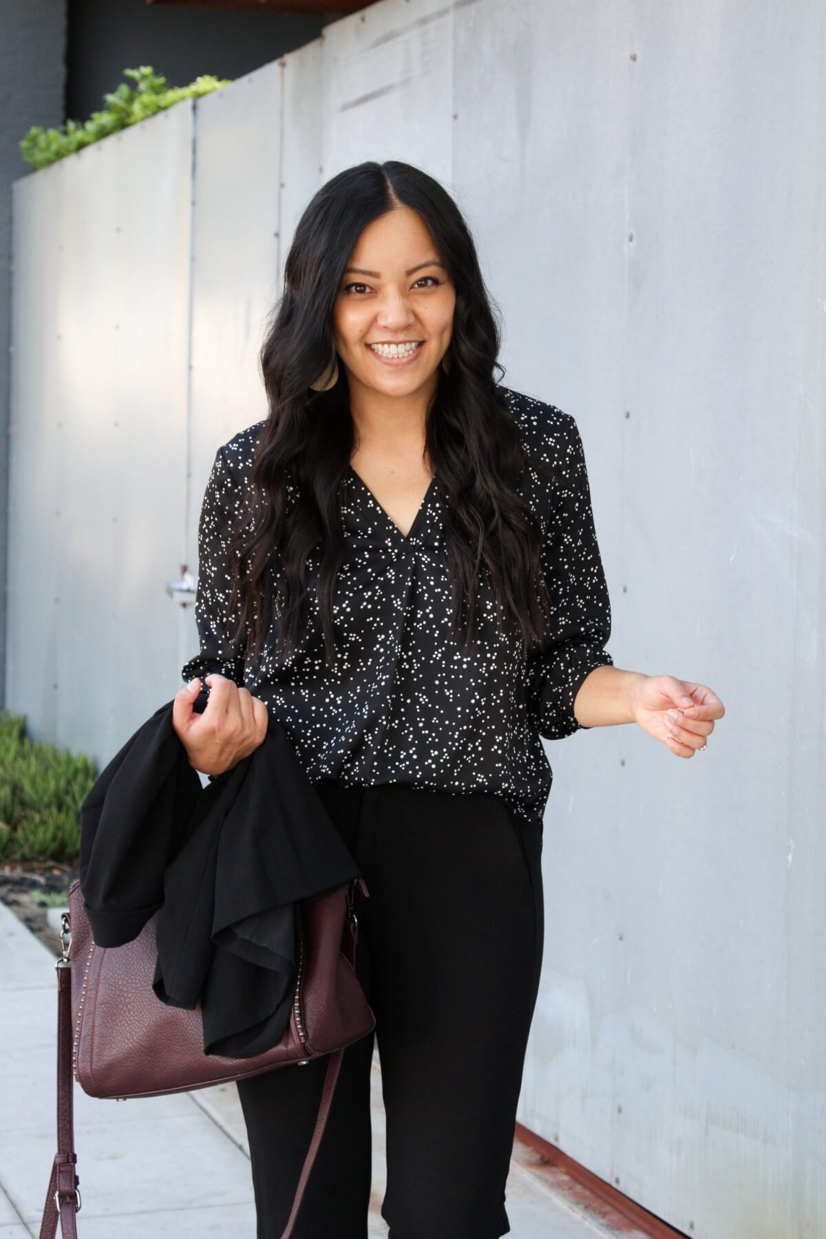 Business Casual Outfit: black blazer + black printed top + black ankle pants + metallic leather earrings + maroon bag
