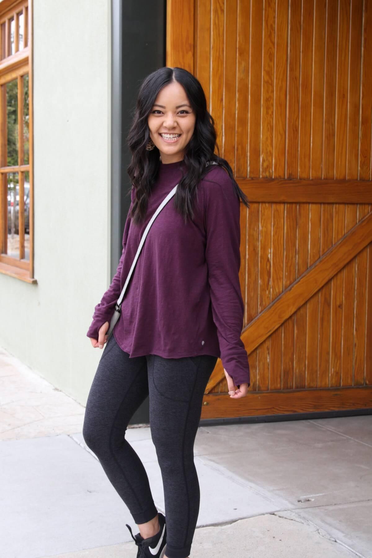 Athleisure Outfit: black pocket leggings + long sleeve purple top + grey crossbody bag + black sneakers + leather leopard print earrings