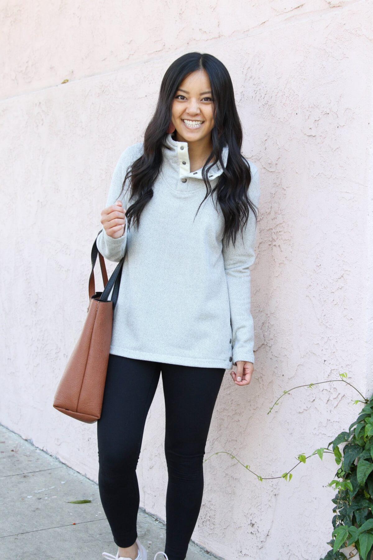 Fall Athleisure Outfit: grey fleece hoodie + black leggings + cognac tote + blush sneakers + cognac tote + pink leather earrings