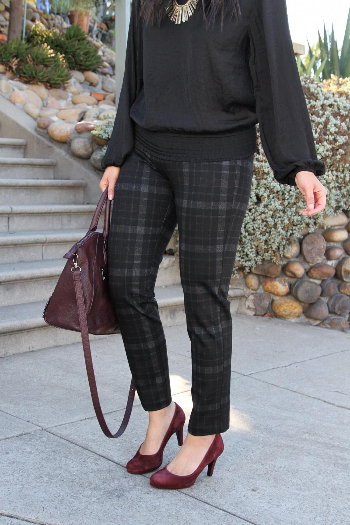 Business Casual Outfit: black plaid skinny pants + black puff sleeve blouse + maroon bag + maroon suede heels + metallic leather earrings + gold fringe statement necklace