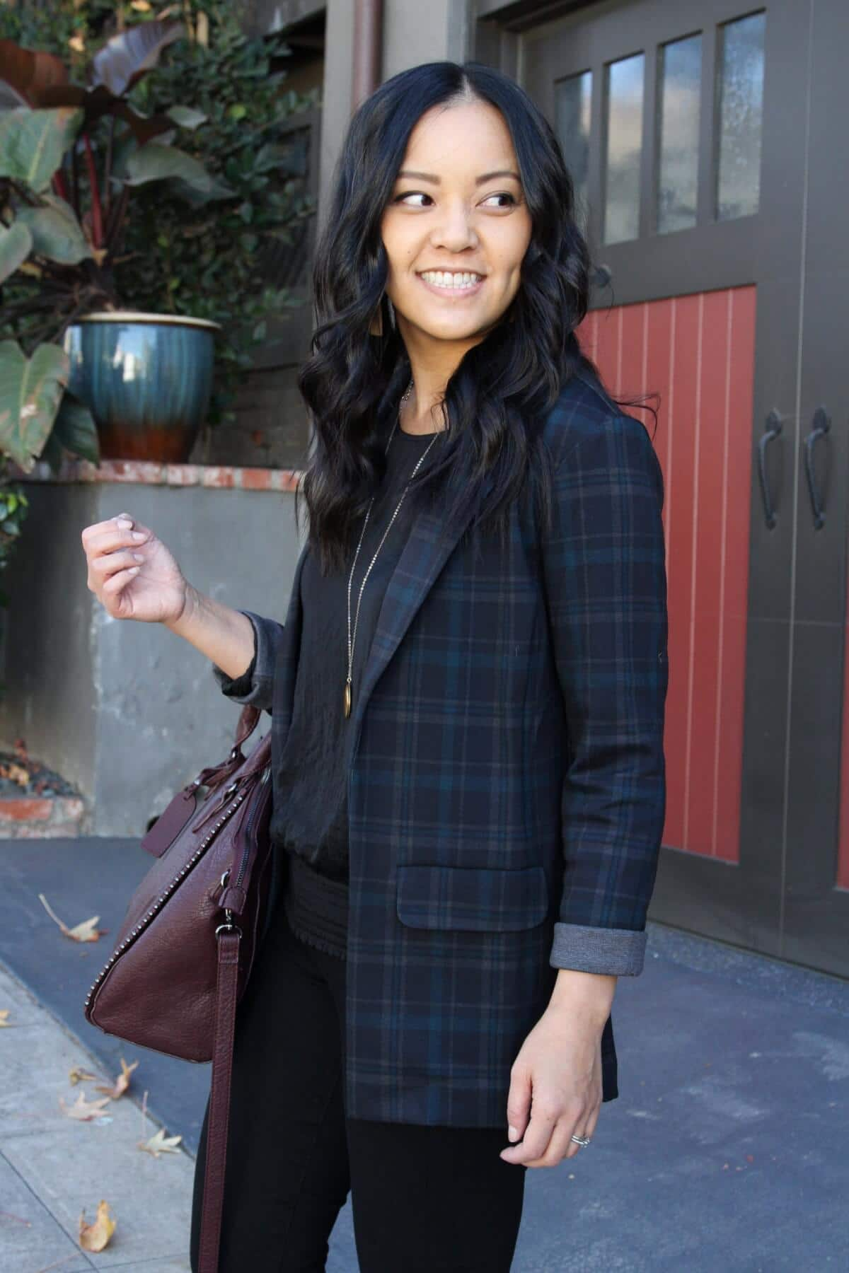 Business Casual Outfit: black plaid blazer + black blouse + black suede heels + black skinny pants + metallic leather earrings + maroon bag + gold circle pendant necklace