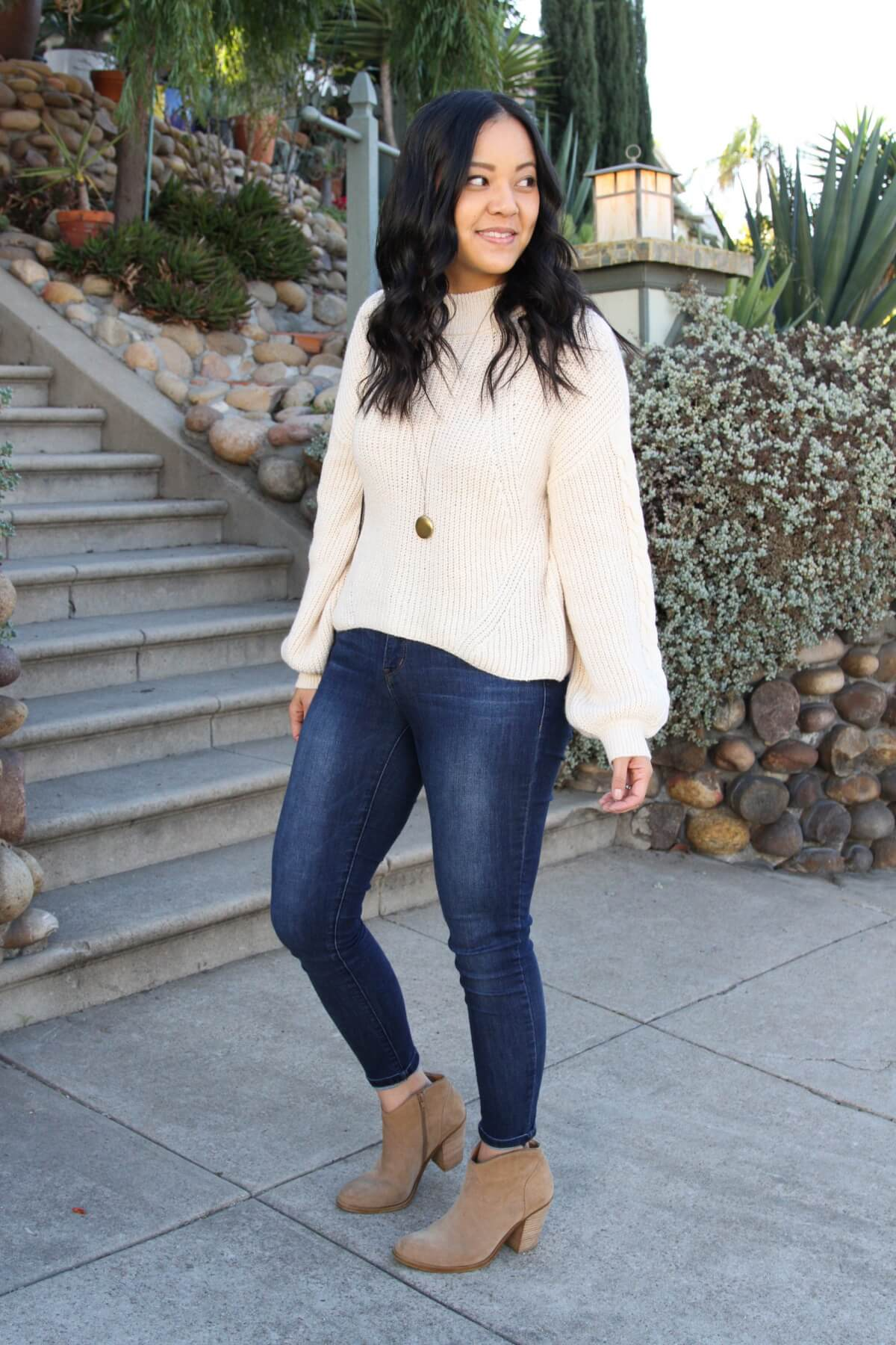 Fall Sweater Outfit: cream dolman sleeve sweater + skinny jeans + taupe suede booties + gold circle pendant necklace