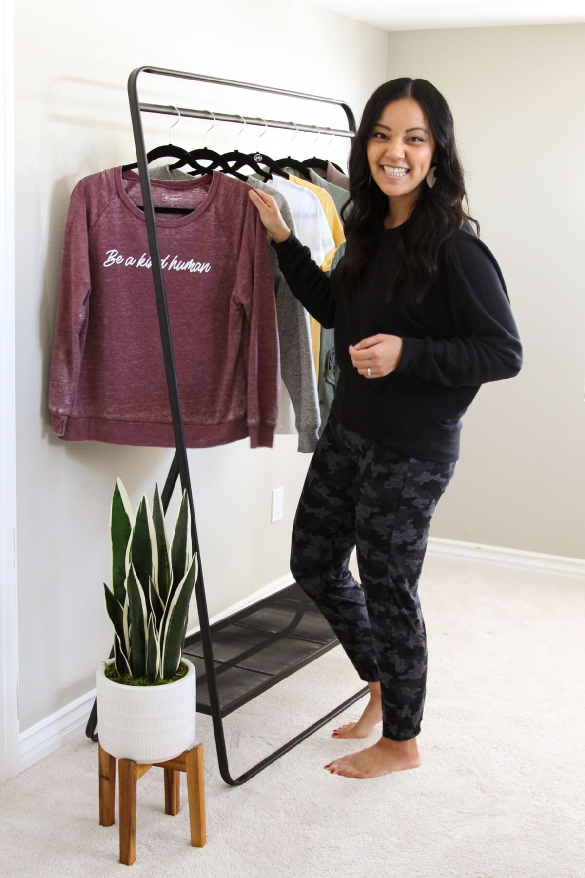 leisurewear outfit maroon message tee + black pullover + camo joggers