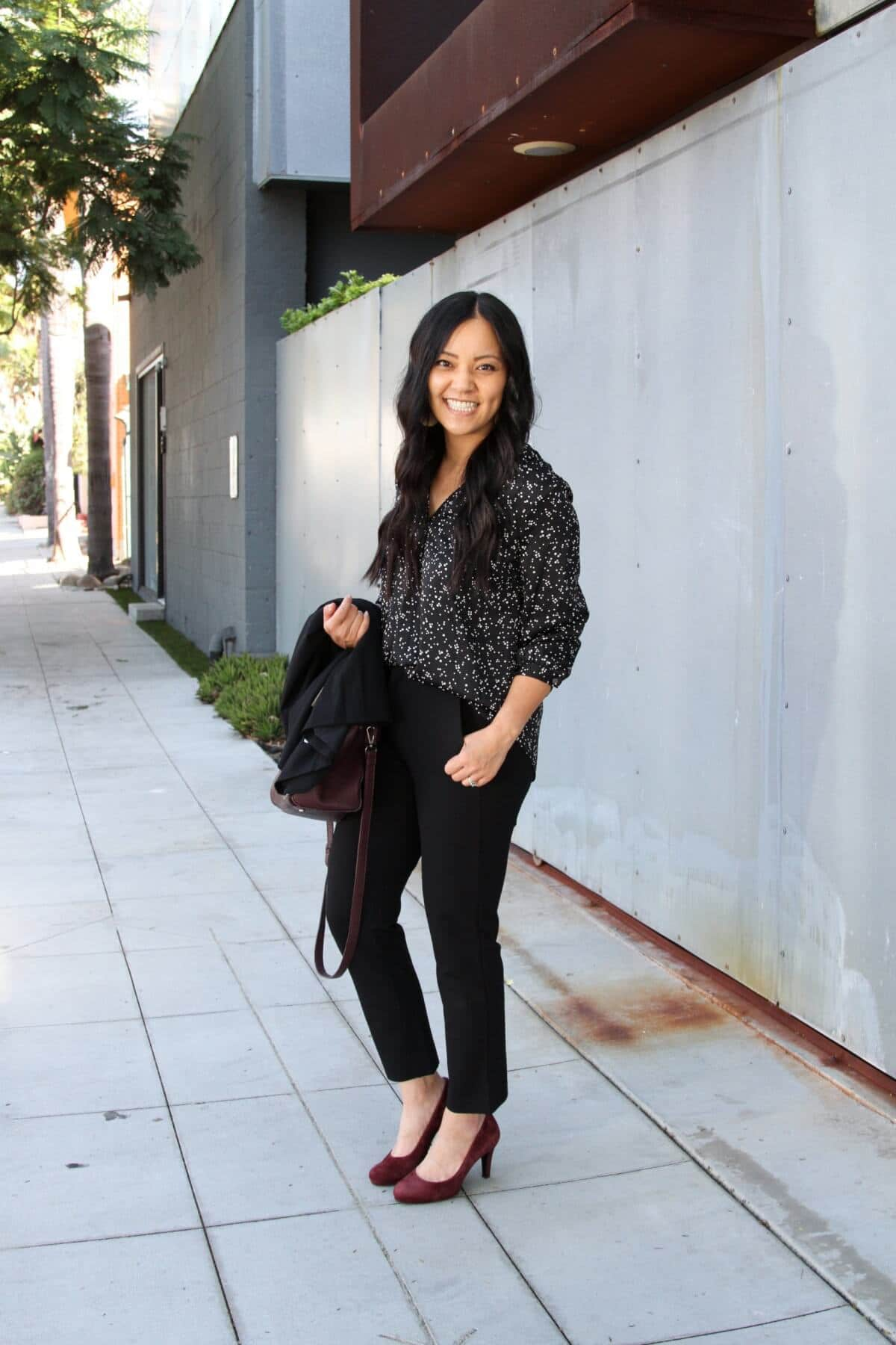 Black and White Spotted Blouse, Black Blazer, Black Ankle Pants, Maroon Suede Heels, and Maroon Bag Outfit Comfy Business Casual Outfit