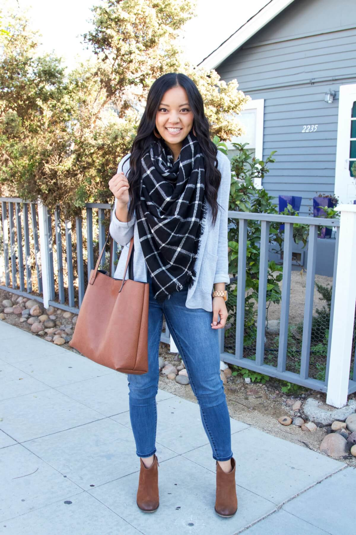 Winter Jeans Outfit: grey cardigan + black and white plaid blanket scarf + skinny jeans + tan suede booties + cognac tote + tan leather earrings