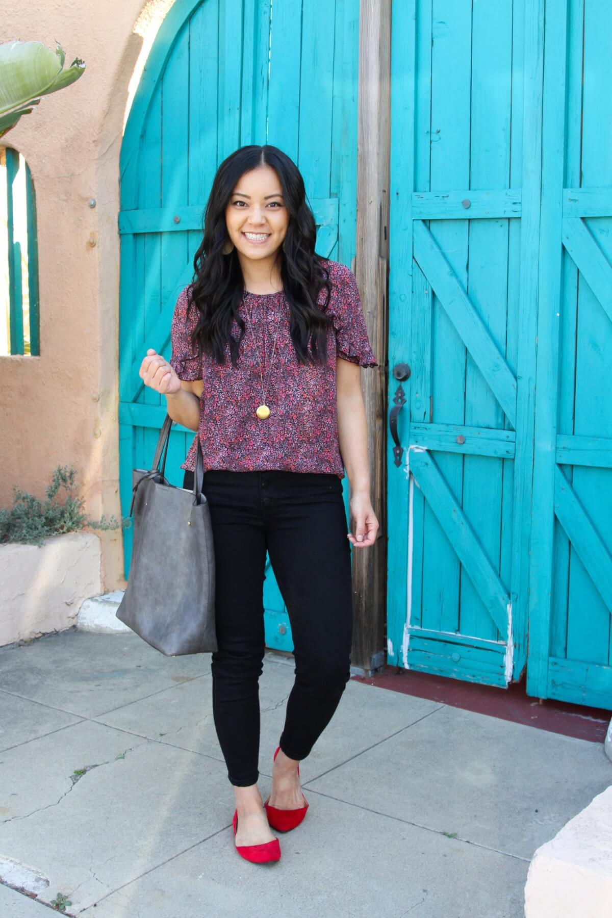 outfit with black jeans for spring: black jeans + colorful printed top