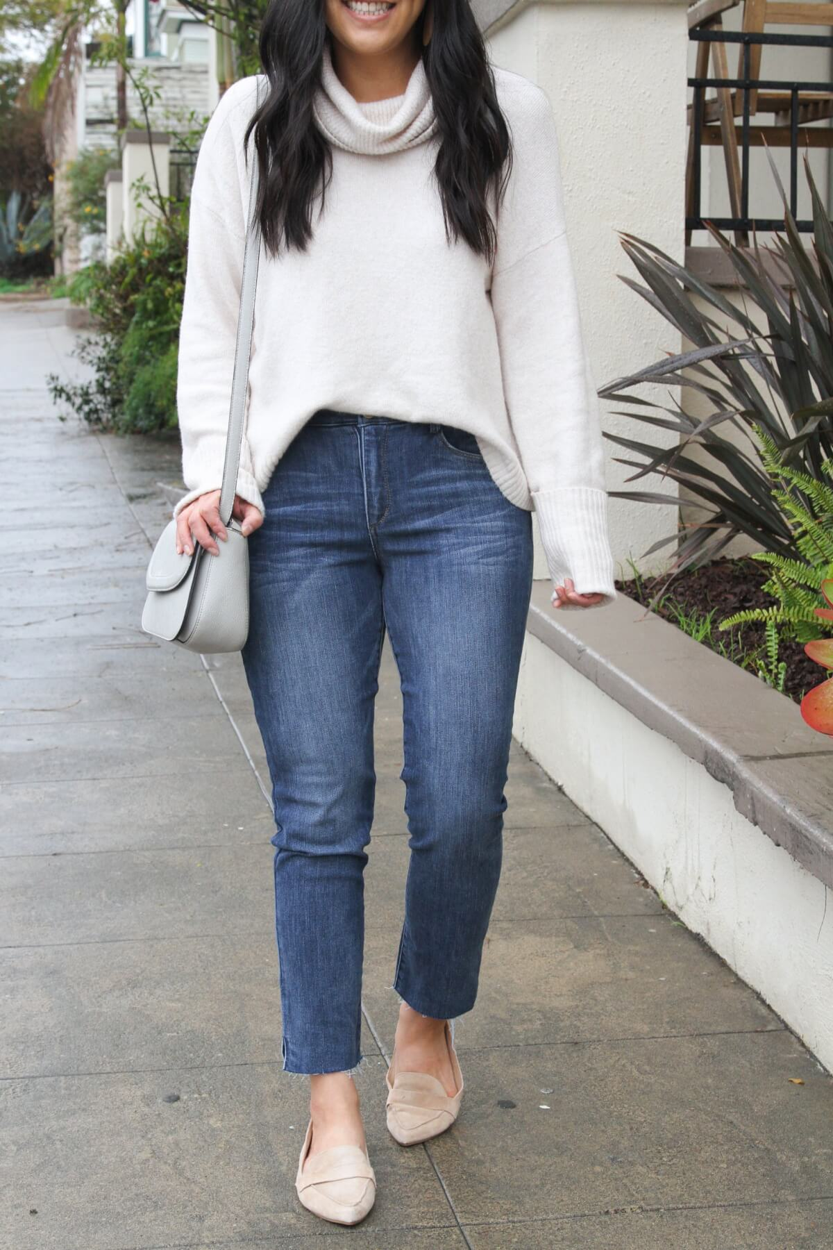 spring outfit: white turtleneck sweater + cropped straight leg jeans + neutral flats + gray purse
