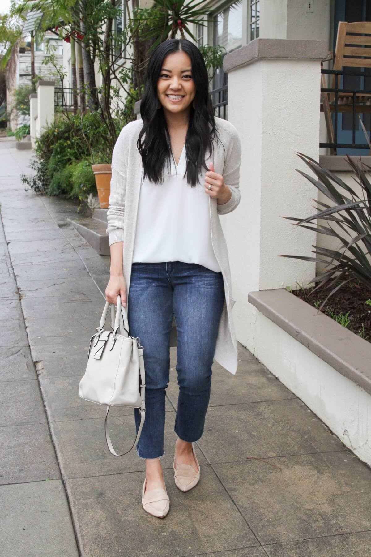 long cardigan outfit: white cardigan + white tunic + straight leg jeans + neutral flats + white handbag