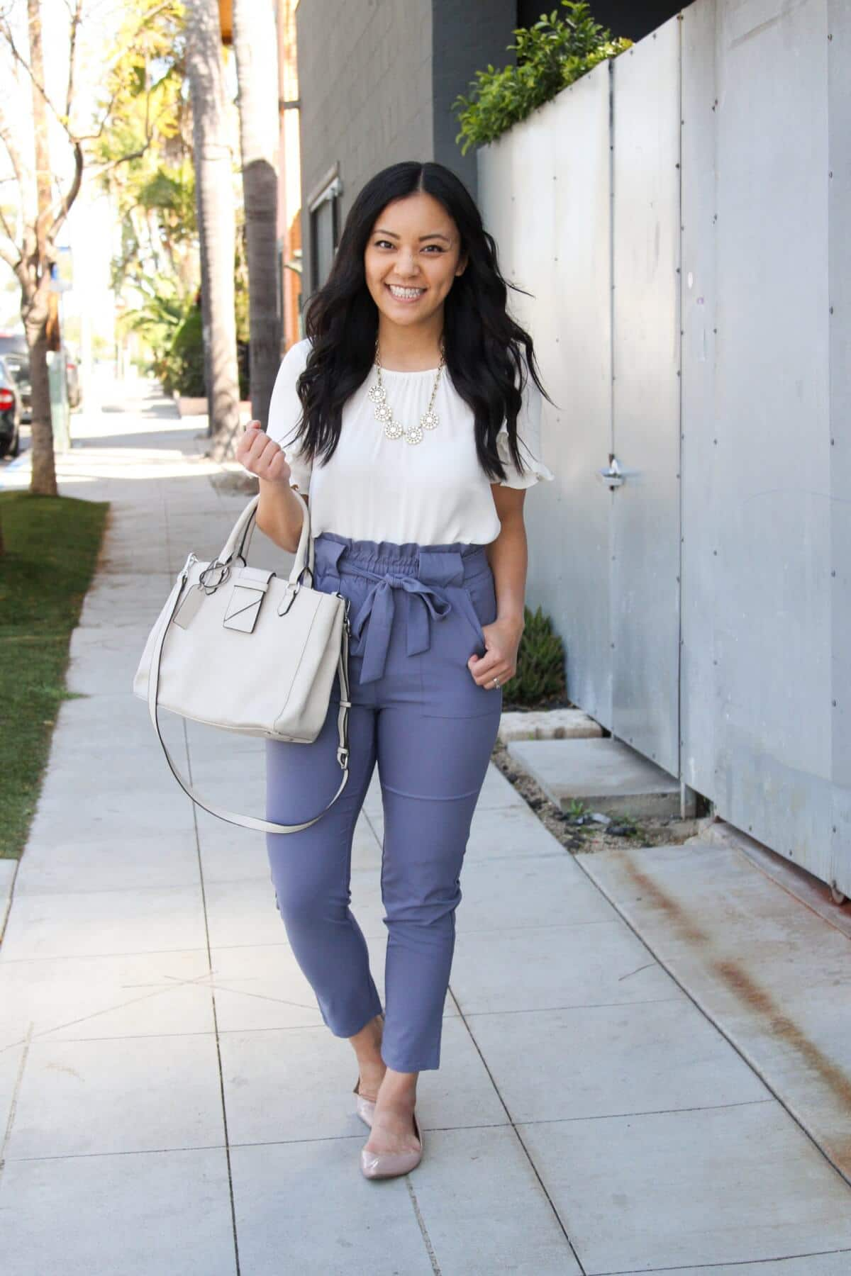 white top for spring: white top, blue paper bag tie-waist pants, nude flats, statement necklace, white bag