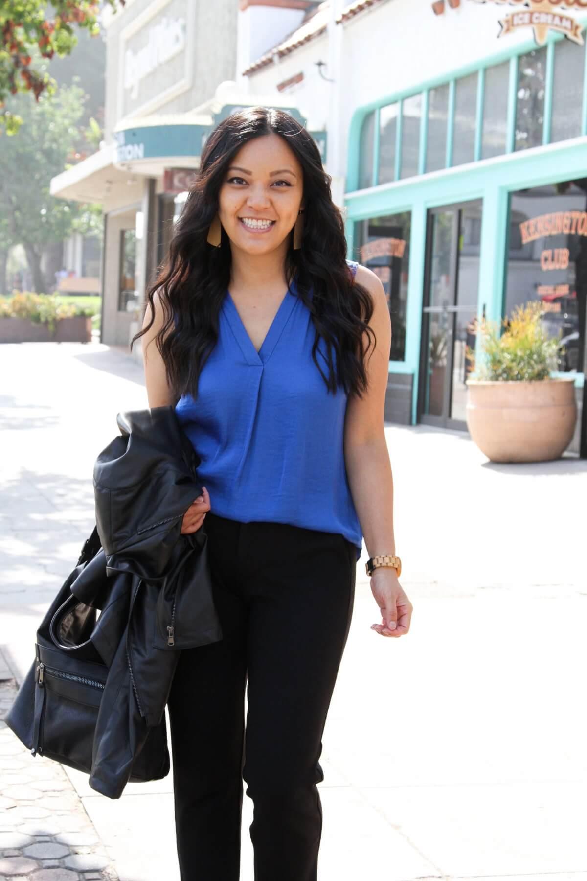 comfy work outfit for spring: blue top, black slacks, black bag