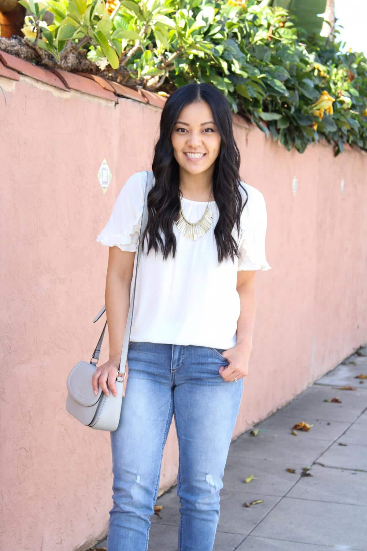 white top for spring: white top, girlfriend jeans, statement necklace, gray bag