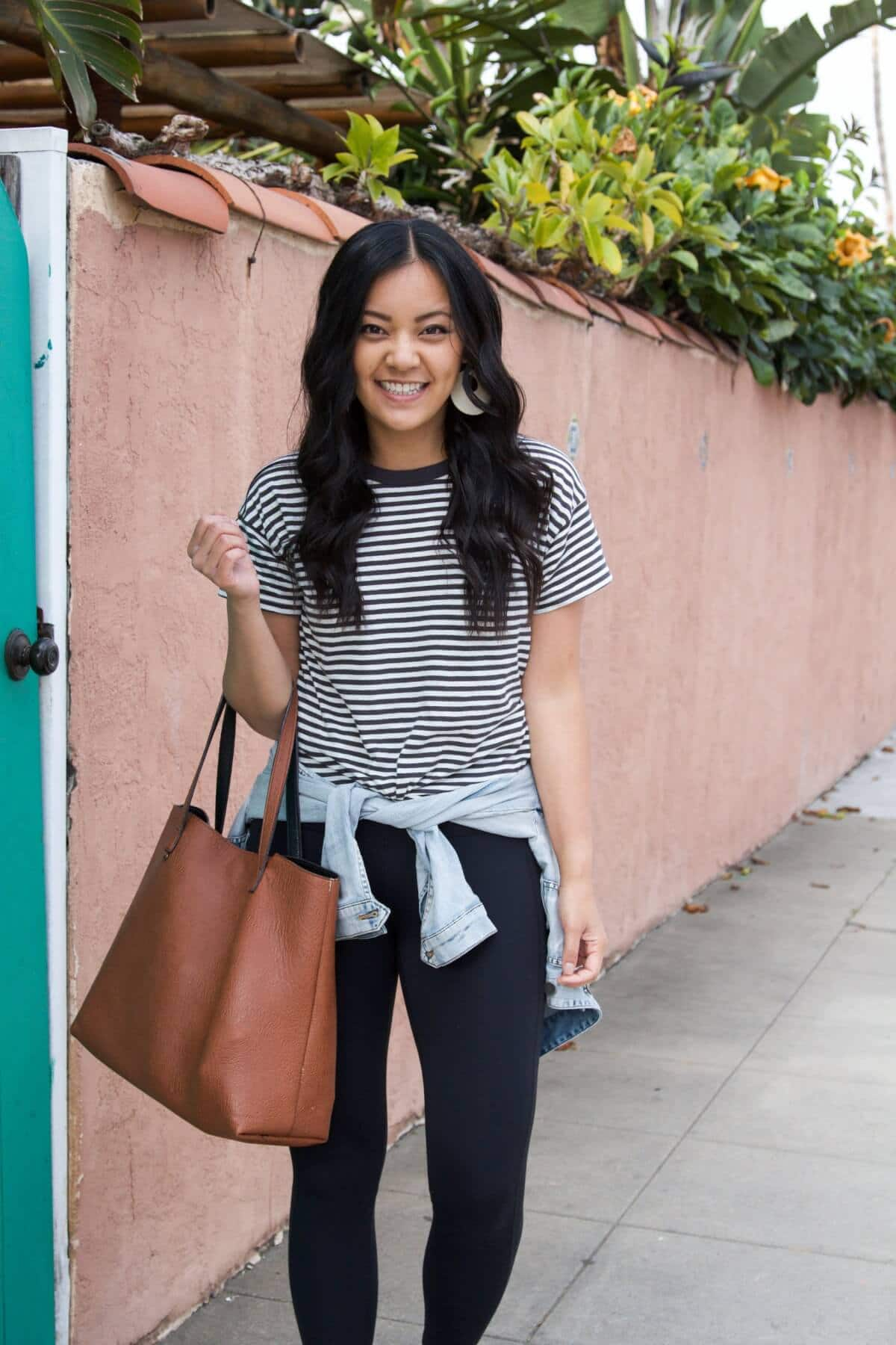 Easy to Wear Shoes for Spring: black and white striped tee + black leggings + denim jacket + white earrings + brown tote