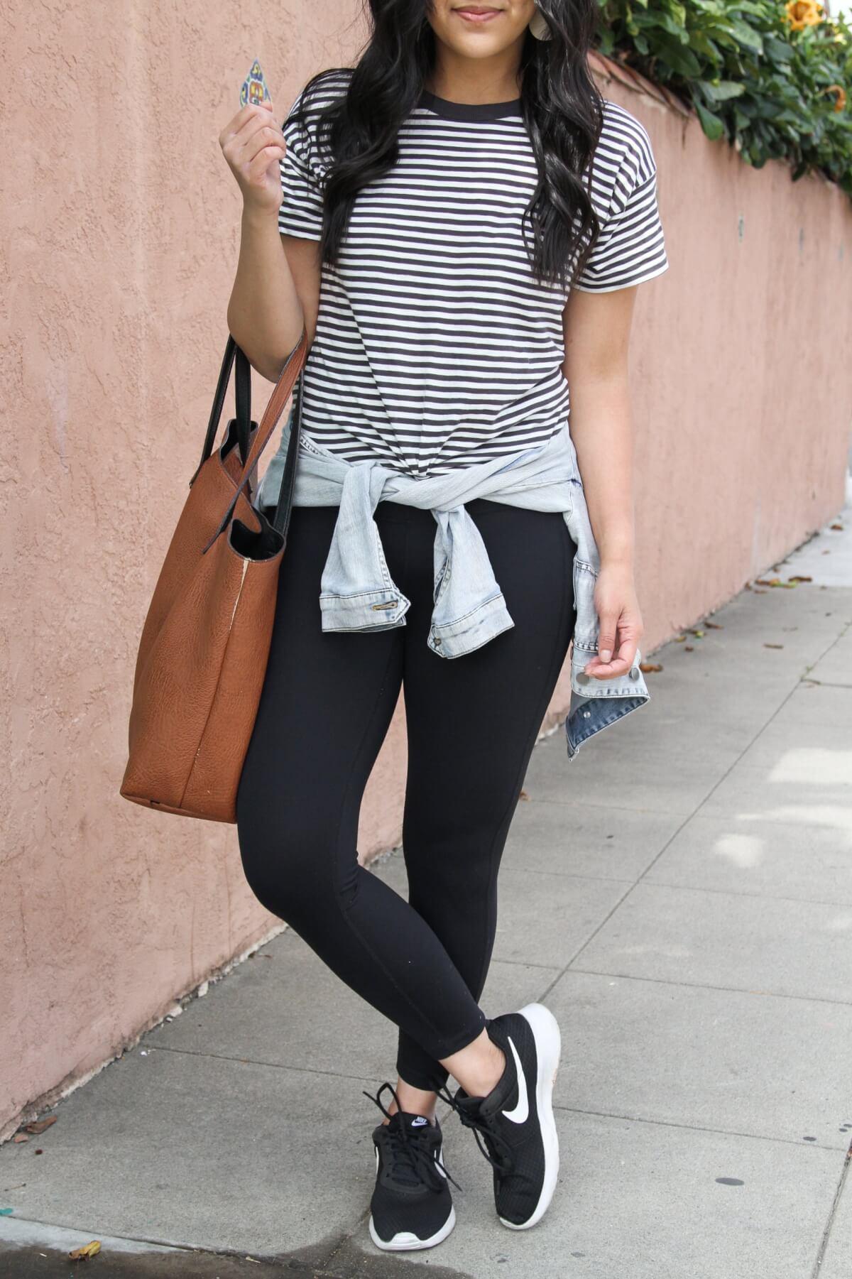 Athleisure Outfit: Madewell Damien black and white stripe tee + Zella Studio Lite black leggings + denim jacket + Nike black sneakers + brown tote close up