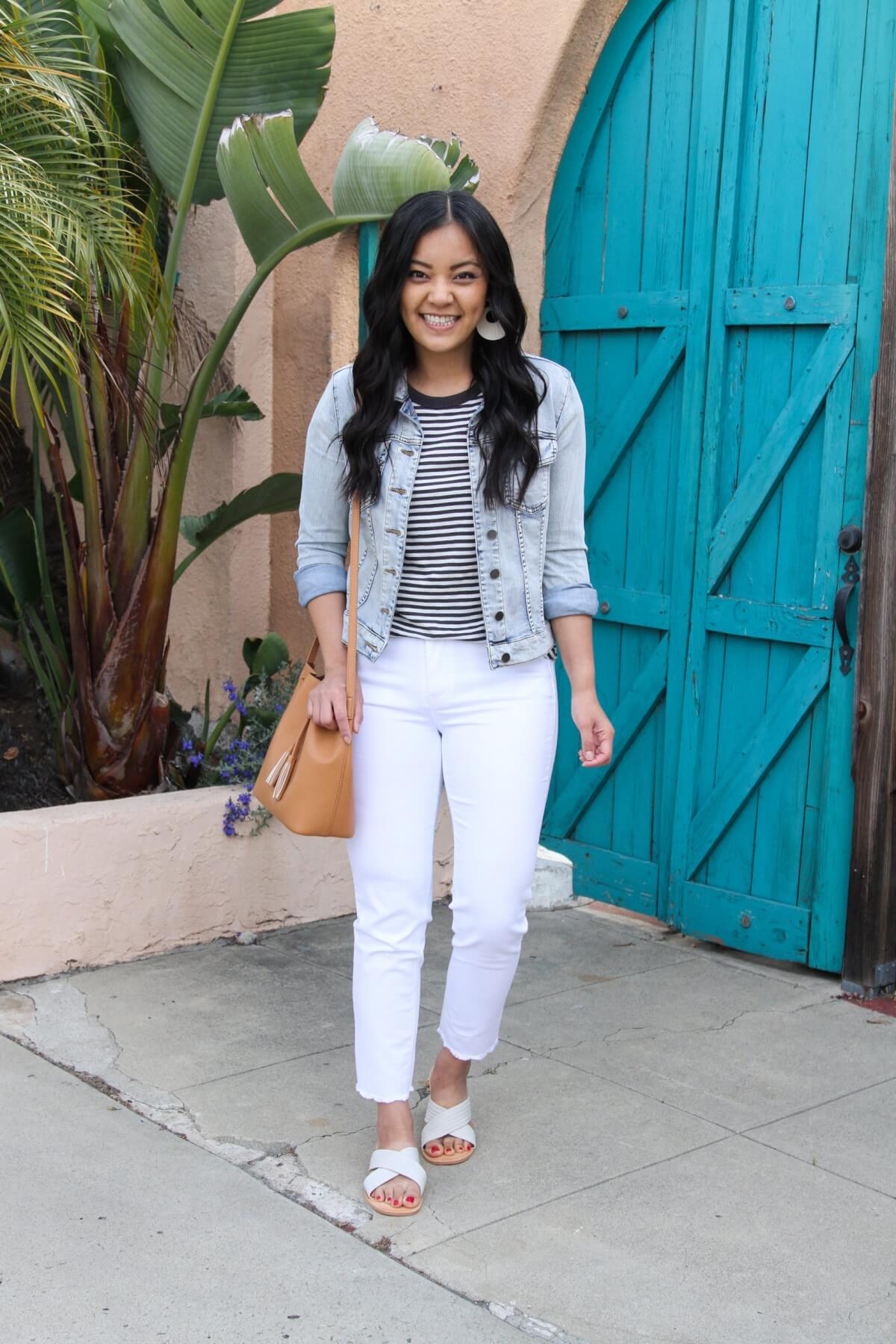 Easy to Wear Shoes for Spring: DV by Dolce Vita Lyra white slides + Madewell black and white striped tee + white straight leg jeans + denim jacket + white earrings + tan bag