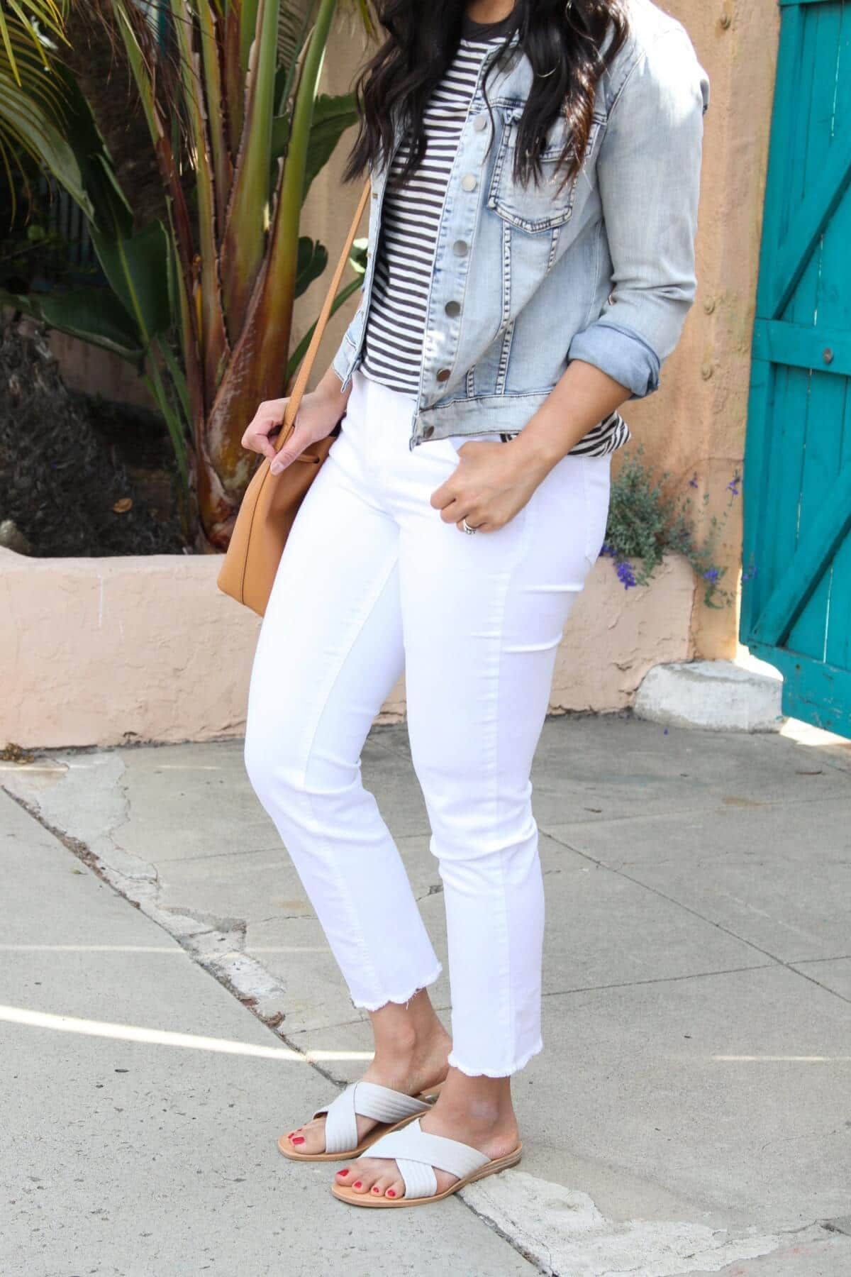 Easy to Wear Shoes for Spring: DV by Dolce Vita Lyra white slides + Madewell black and white striped tee + white straight leg jeans + denim jacket + tan bag