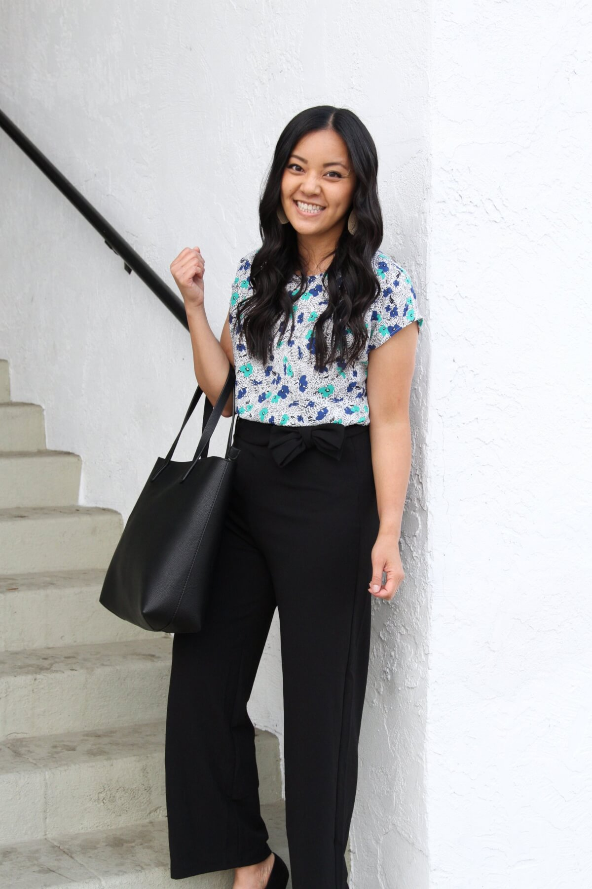 Work Outfit: blue and green floral top + black wide leg tie waist pants + statement necklace + black tote