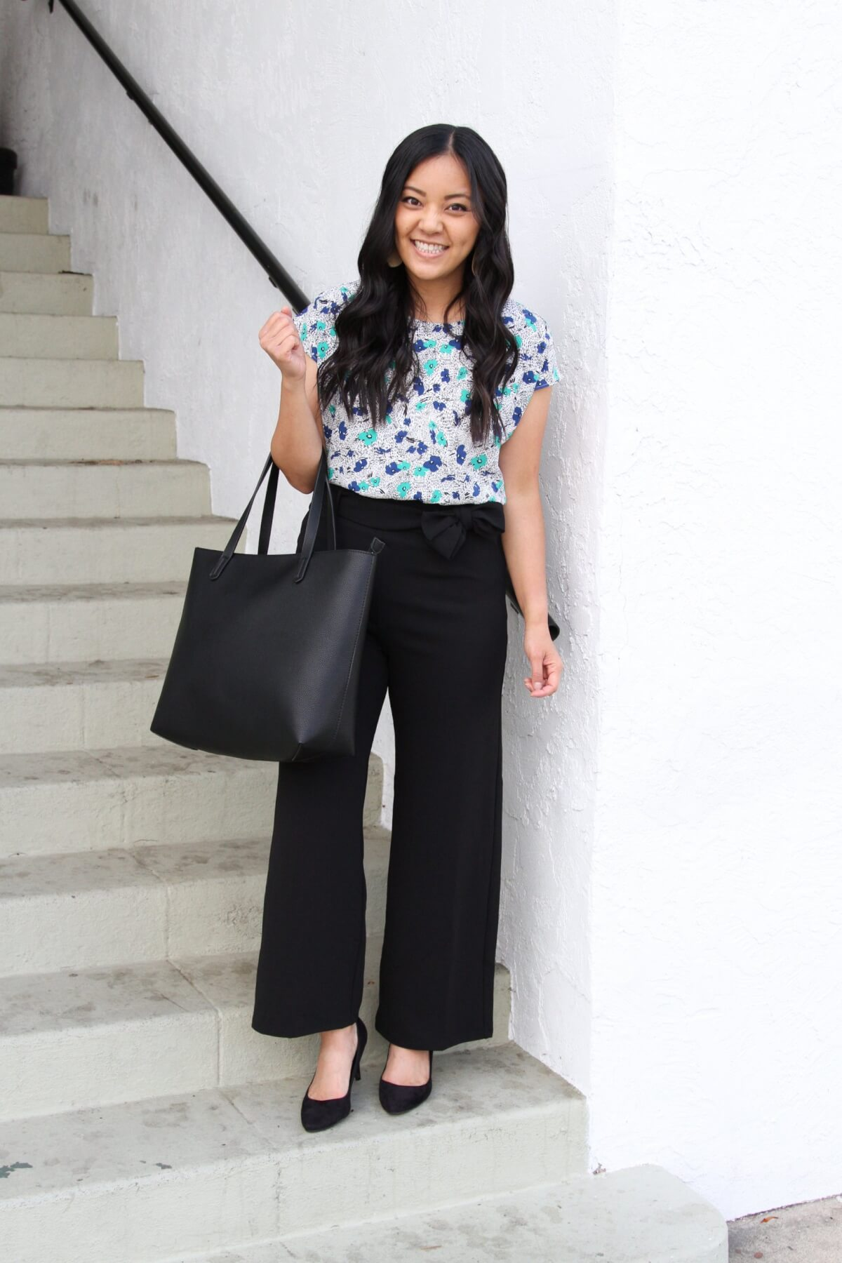 Work Outfit: blue and green floral top + black wide leg tie waist pants + black pumps + statement necklace + black tote
