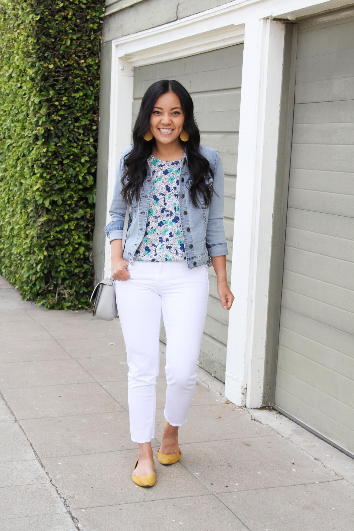 Elevated Casual Outfit: blue and green floral top + white jeans + yellow flats + denim jacket + yellow earrings + gray bag