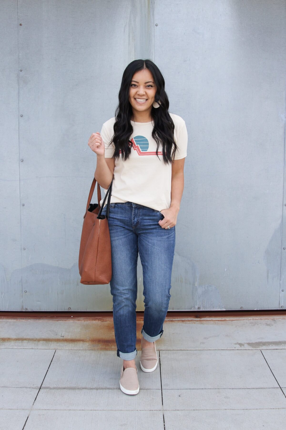 Easy to Wear Shoes for Spring: Oatmeal Naturalizer slip-on sneakers + graphic tee + KUT from the Kloth boyfriend jeans + white earrings + brown tote