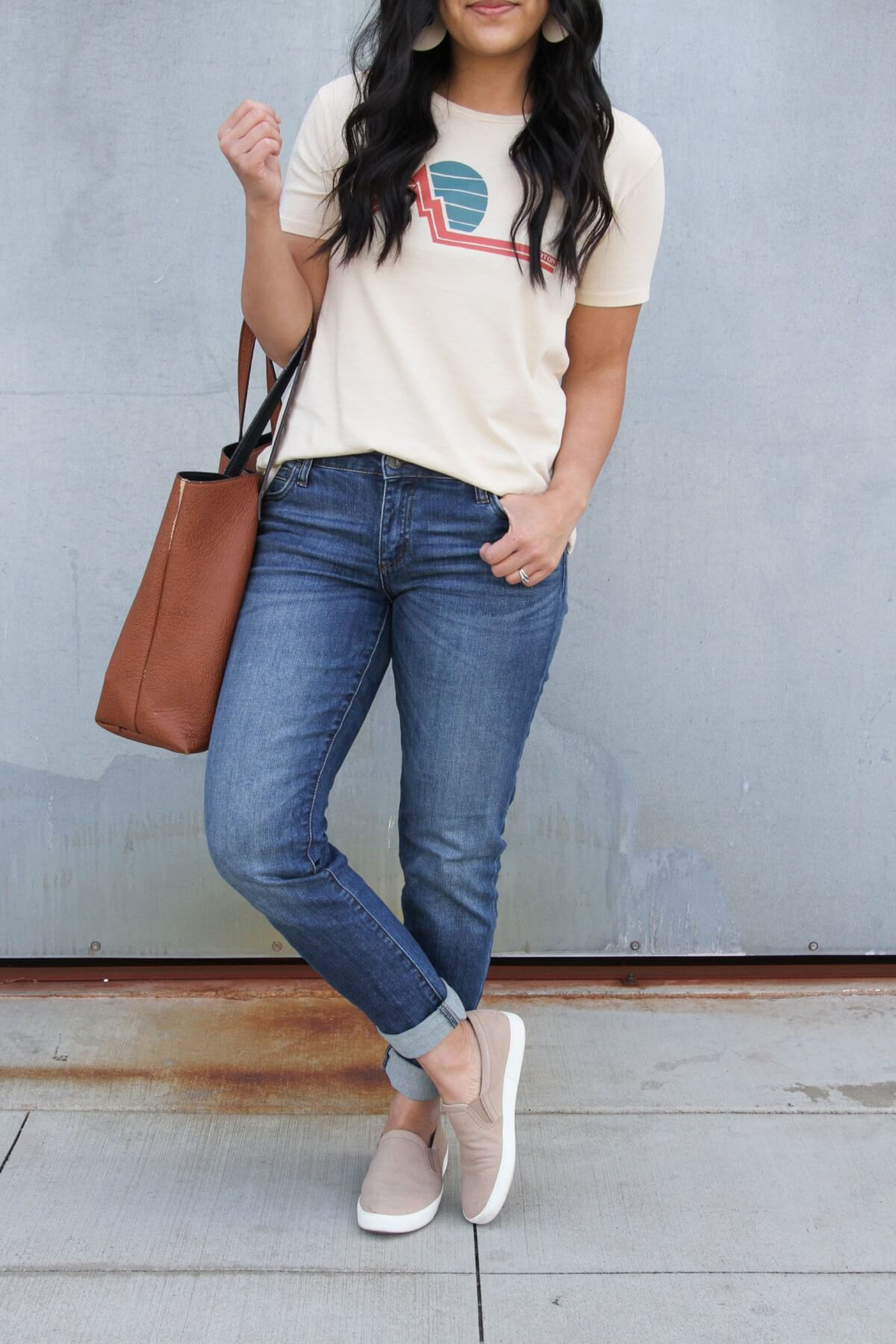 Easy to Wear Shoes for Spring: Oatmeal Naturalizer slip-on sneakers + graphic tee + KUT from the Kloth boyfriend jeans + white earrings + brown tote close up