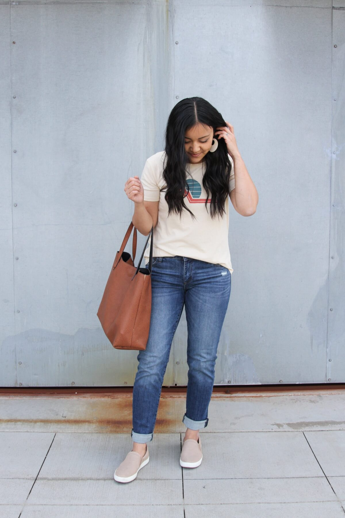 Easy to Wear Shoes for Spring: nude Naturalizer slip-on sneakers + graphic tee + KUT from the Kloth boyfriend jeans + white earrings + brown tote