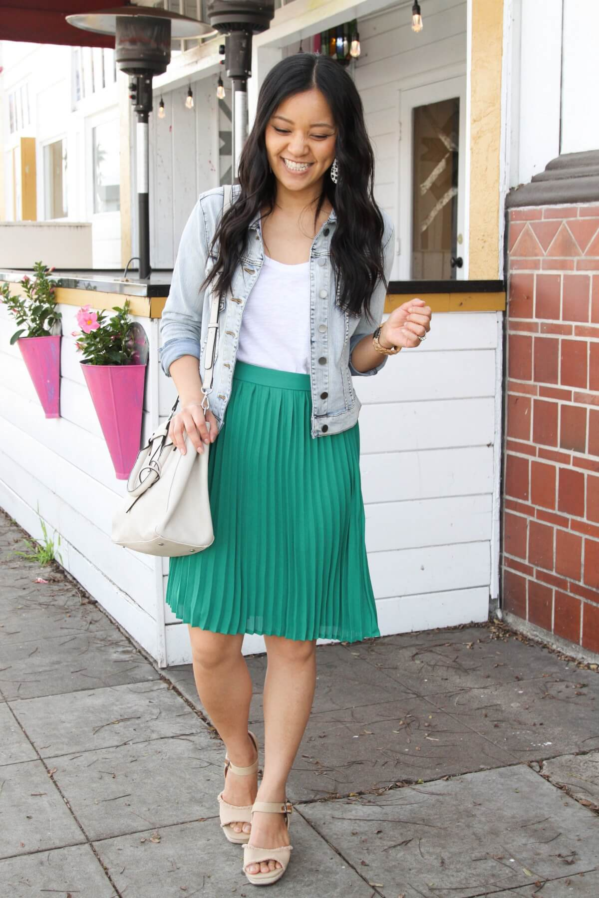 Classic Outfit: denim jacket + white tee + green pleated skirt + nude heels + white and black earrings + white bag