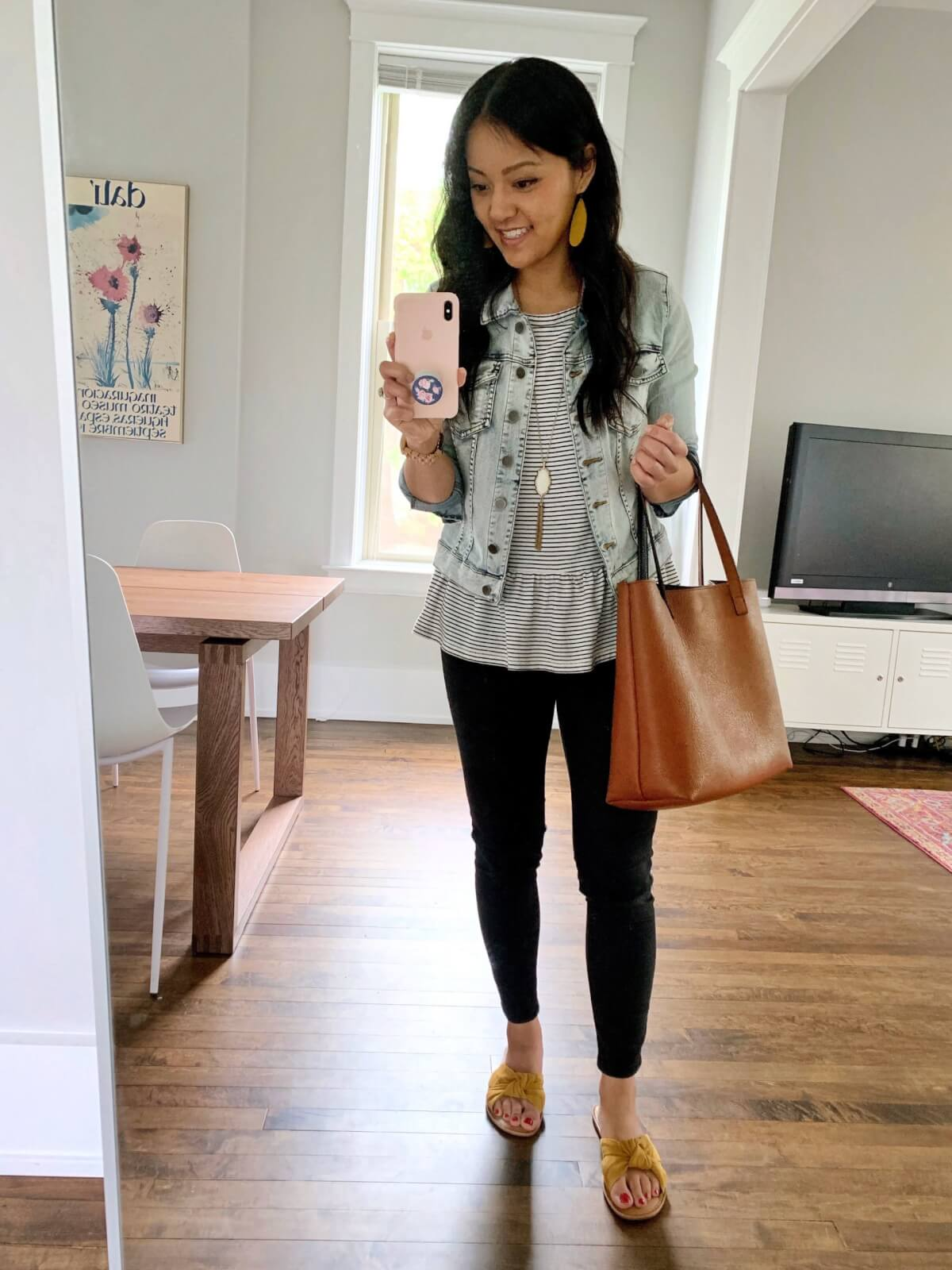 denim jacket outfit: denim jacket + striped peplum tee + black jeans + yellow sandals + brown tote + pendant necklace + yellow earrings