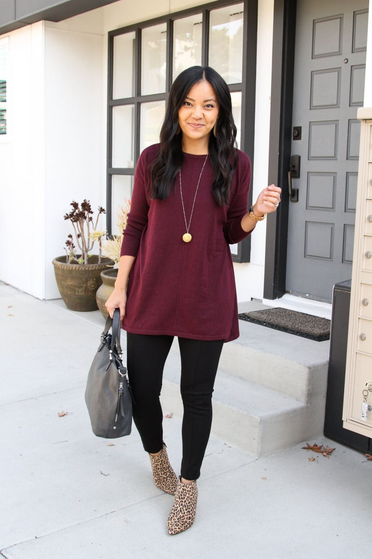 Classic Outfit: maroon tunic sweater + black leggings + leopard booties + pendant necklace + gray bag