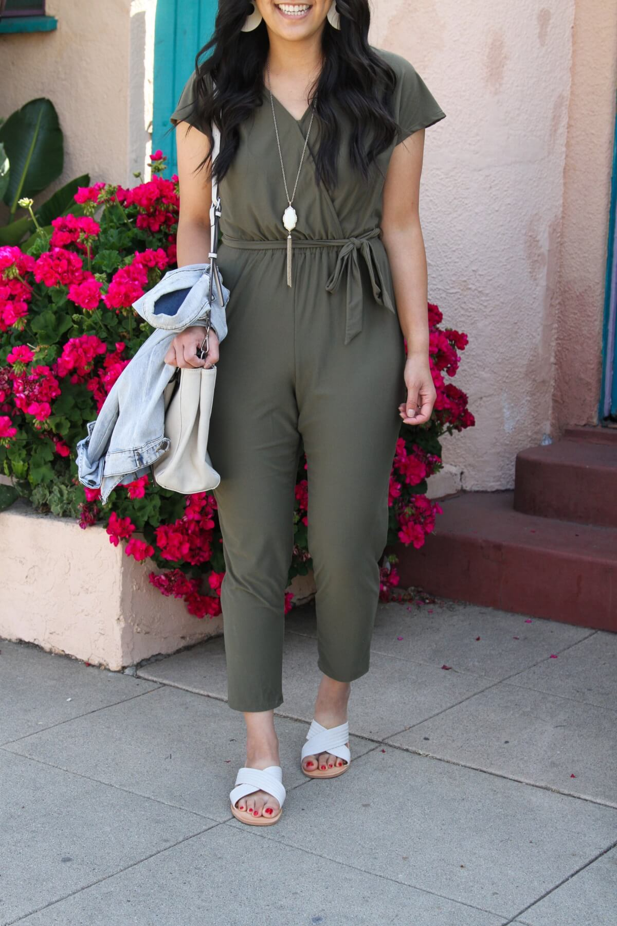 Lunch with Friends Outfit: olive jumpsuit + white slide sandals + denim jacket + white bag